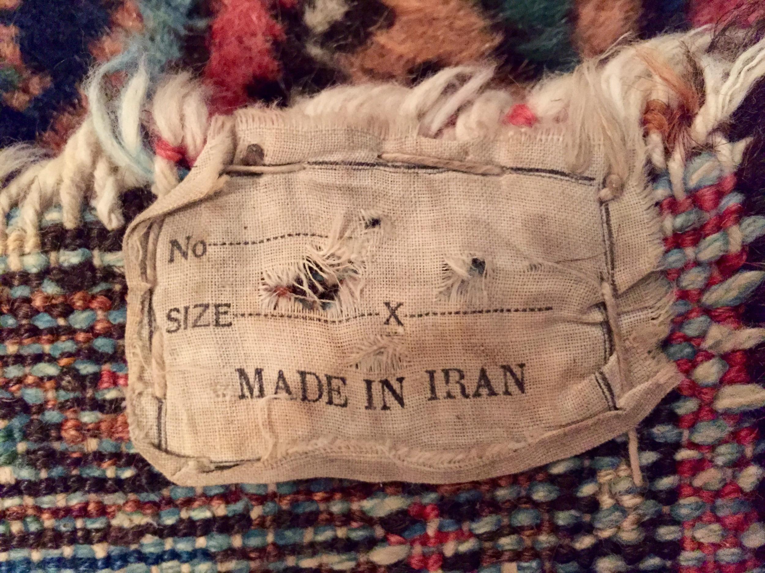 Label on back side of rug.