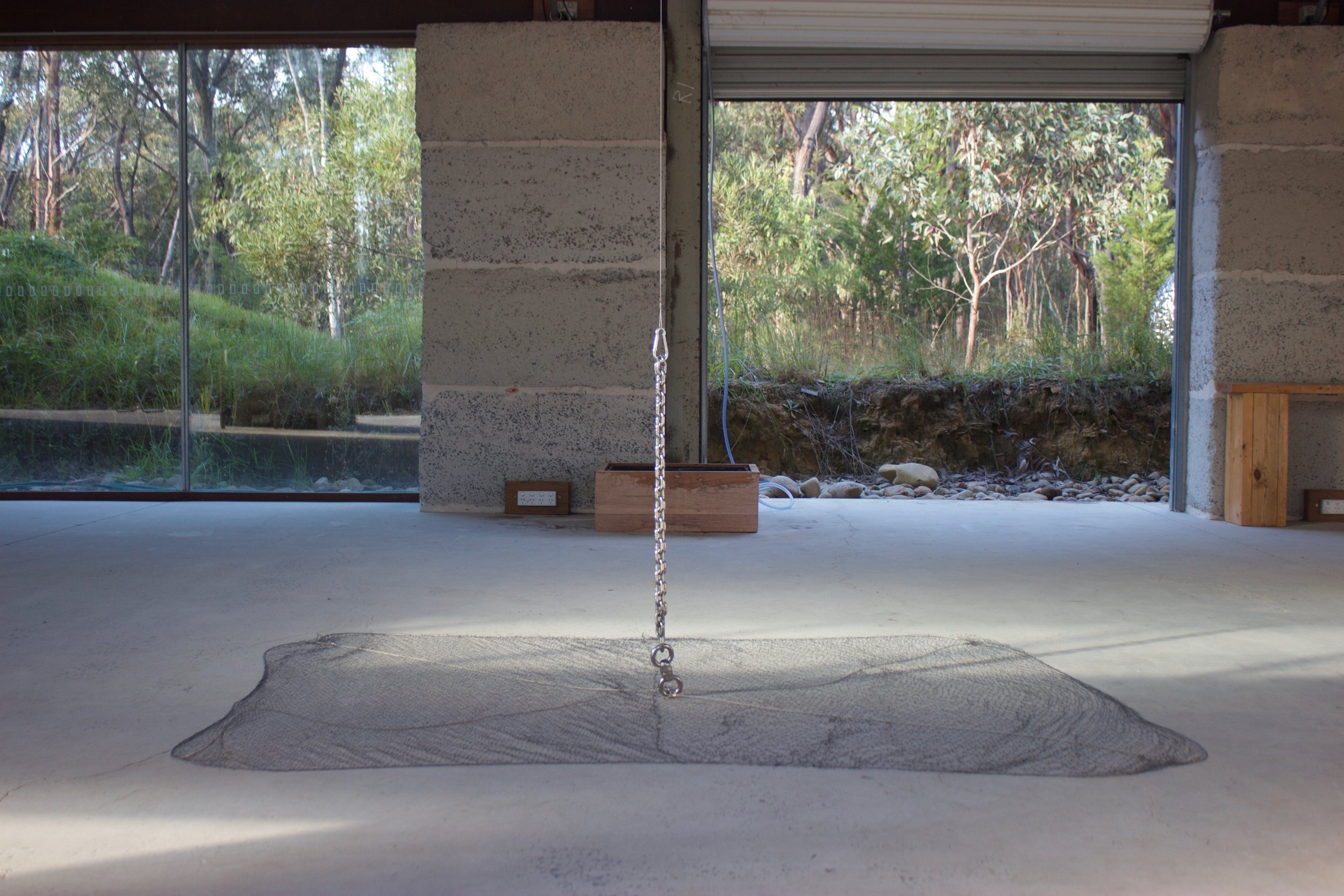 No One Should Be Alone In Their Old Age . Kinetic installation with hand-knotted net, stainless steel and water. Dimensions variable.  Made and presented at the Bilpin International Ground for Creative Initiatives in Bilpin, Australia. 2017.