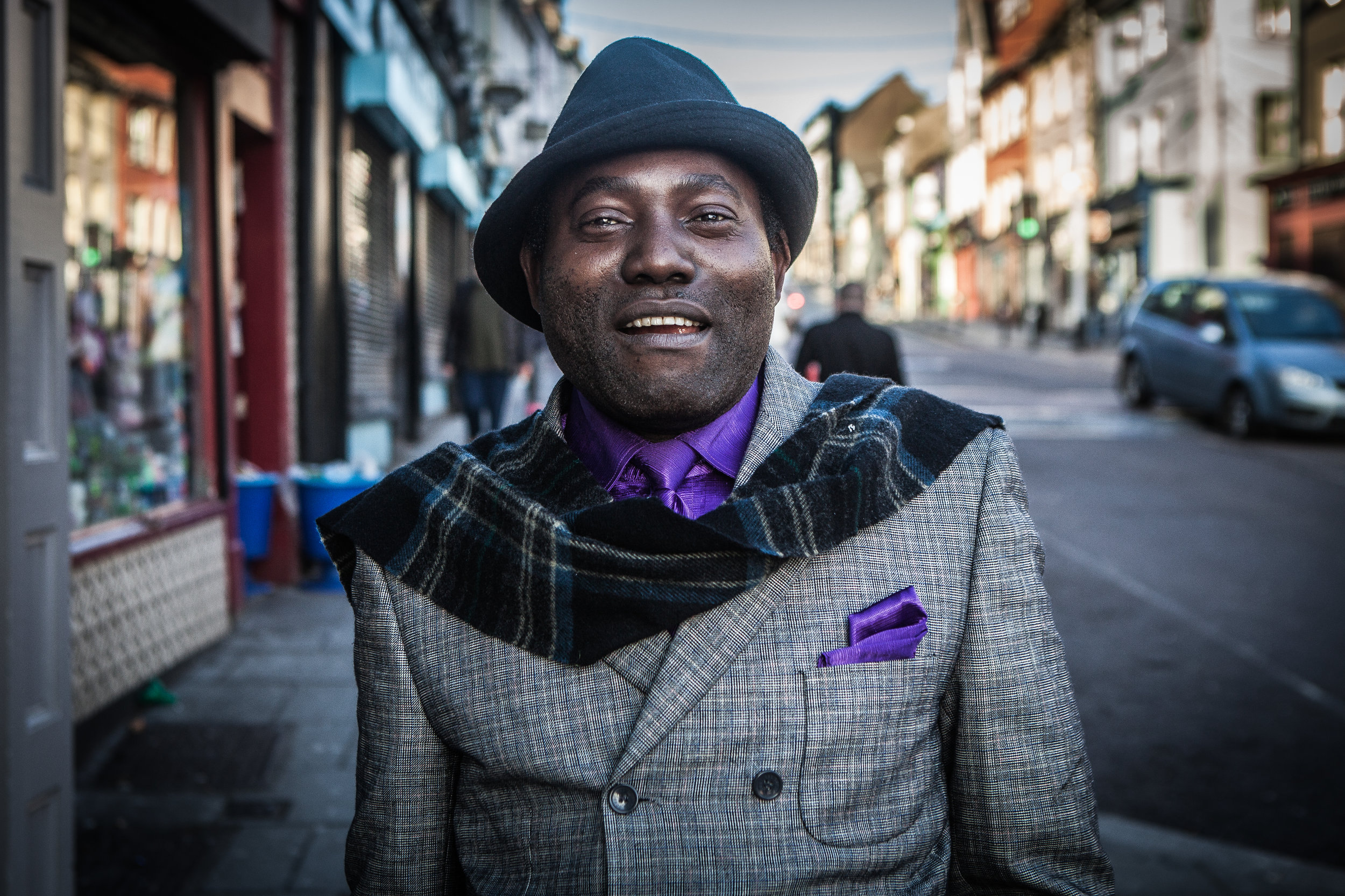 I met Daniel, originally from Congo as he came out of church service on Barrack street.  Such a sharply dressed man!  He is one of those characters that will break out into a huge smile or laugh at the slightest hint, maybe he was still buzzing after his weekly spiritual fix.  We discussed the concept of the well dressed African 'Sapeur' he claimed not to be one but I convinced him he must be.   We chatted about the fashion sense of the Irish male and he told me they were too stingy to dress up well and preferred to spend their money on other things.  I guess we all generalise of sorts... but he may have a point, after all I admit I was decked out in a pair of old runners, jeans, an old coat and particularly crappy wooly hat...
