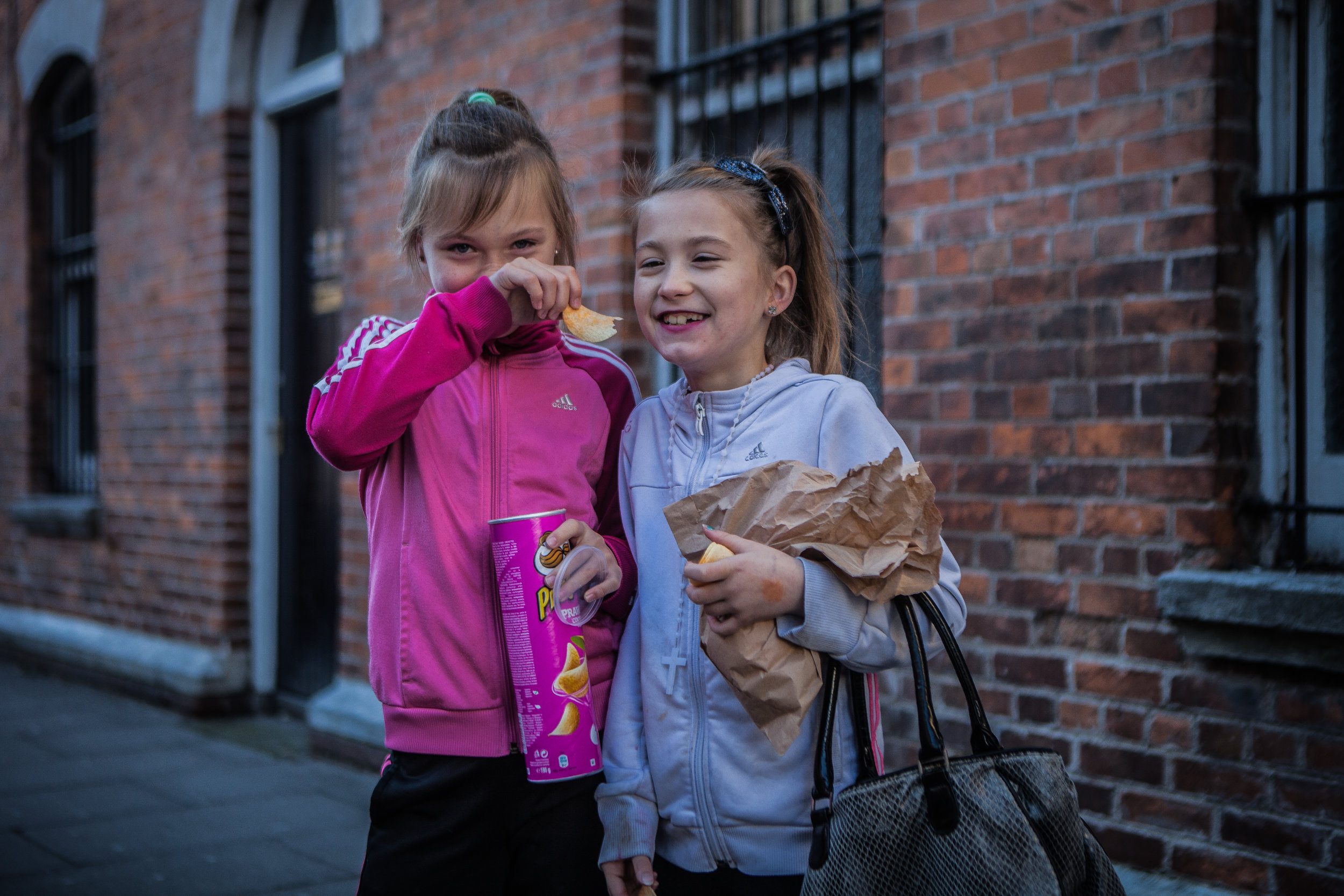 Nicole and Celina had just eaten their Sunday lunch but that didn't stop them from launching into a box of pringles (Which nicely matched her attire!?