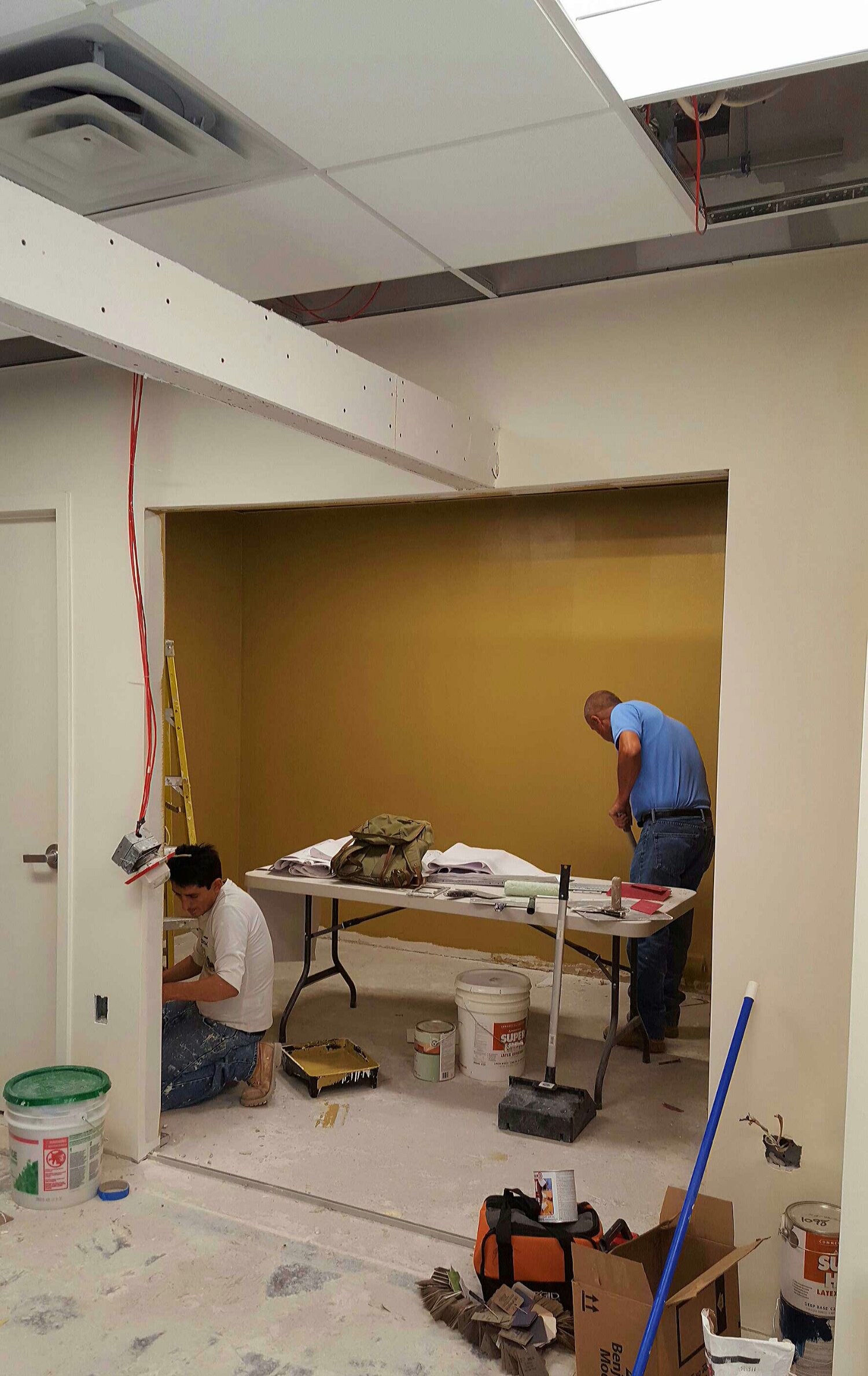 The conference room has its first coat of Benjamin Moore's Toasted Almond.
