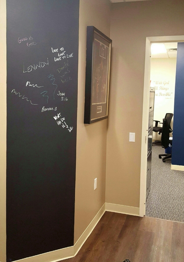 Black Chalk Board paint, from Benjamin Moore has been applied to the wall, so it can be used as an information work center and a play wall for when the kids visit.