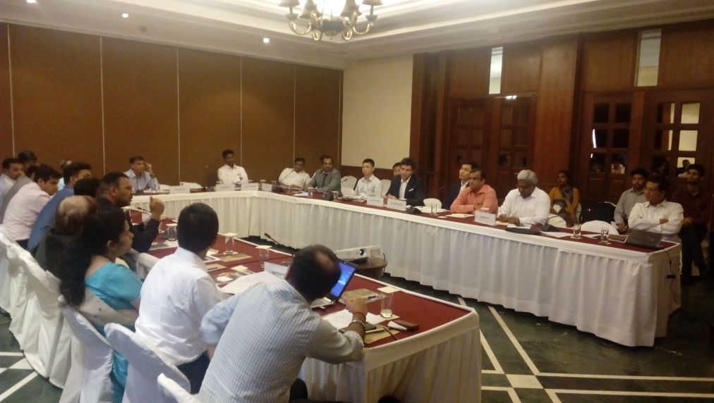 Ravi Krishnan, Managing Director (left) speaking at Roundtable in India.