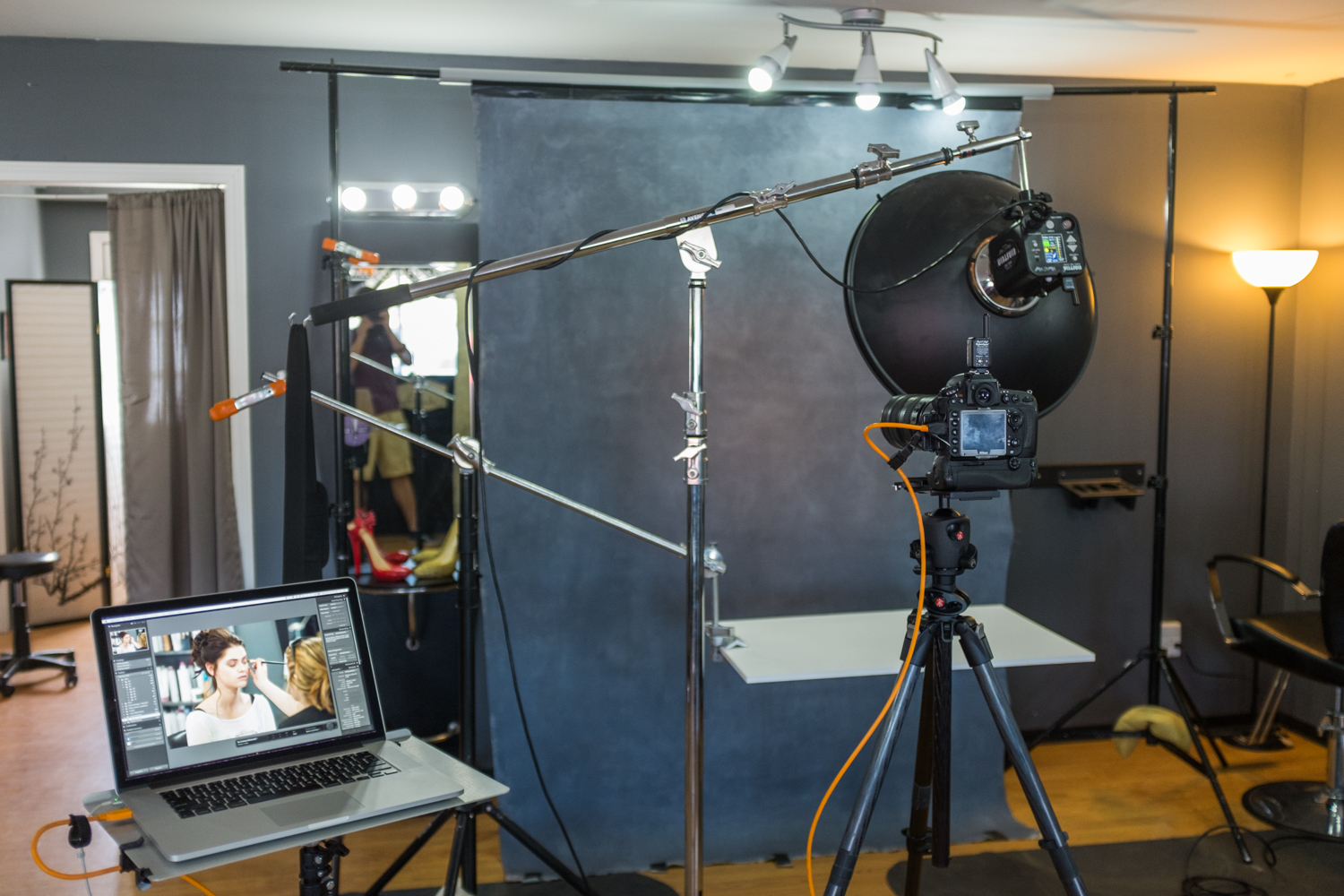 Behind the scenes of the lighting setup I used for the shoot, tethering to my laptop.