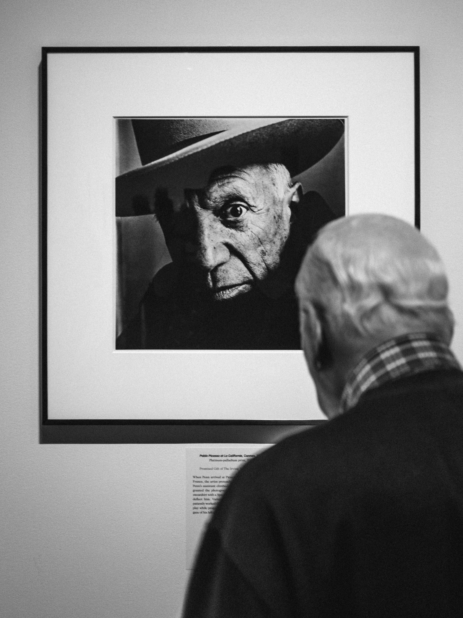 A visitor to the exhibit views Penn's famous photograph of Pablo Picasso.