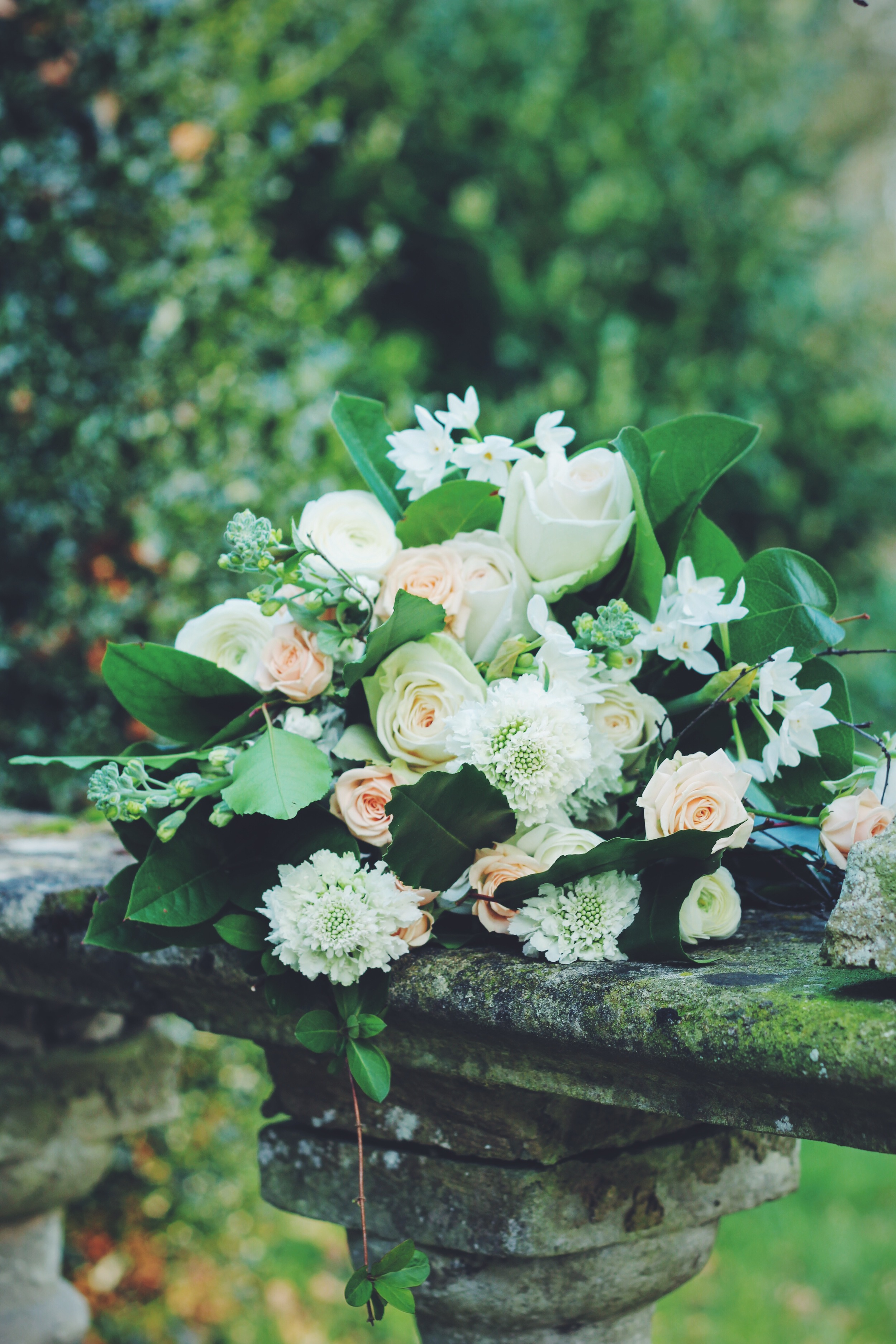 garden style bouquet by Jennifer Pinder. White flowers with touches of peach. Flowers include roses, scabious, narcissi and ranunculus