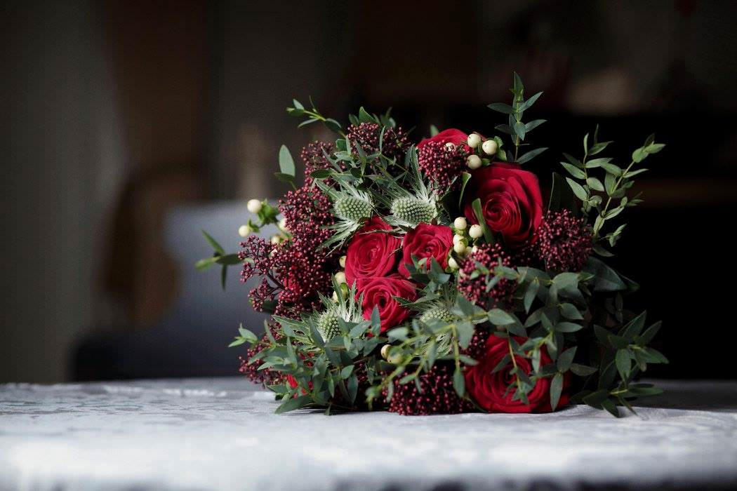 A christmas wedding bouquet by Jennifer Pinder at the Dulwich College Old Library photograph by Ben Joseph