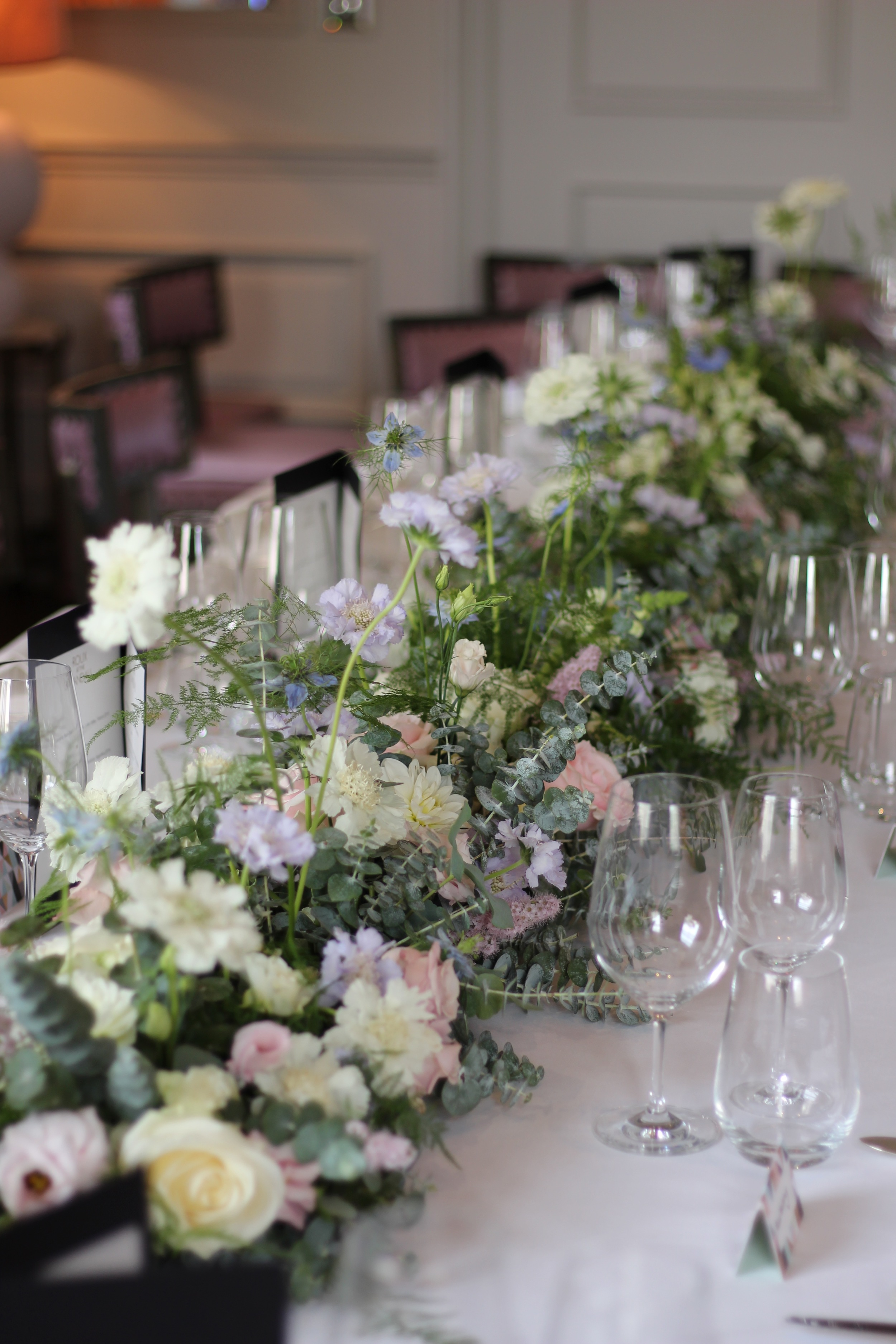 pastel pink and lilac and white wedding bouquet by Kent florist Jennifer Pinder at the Langham in London