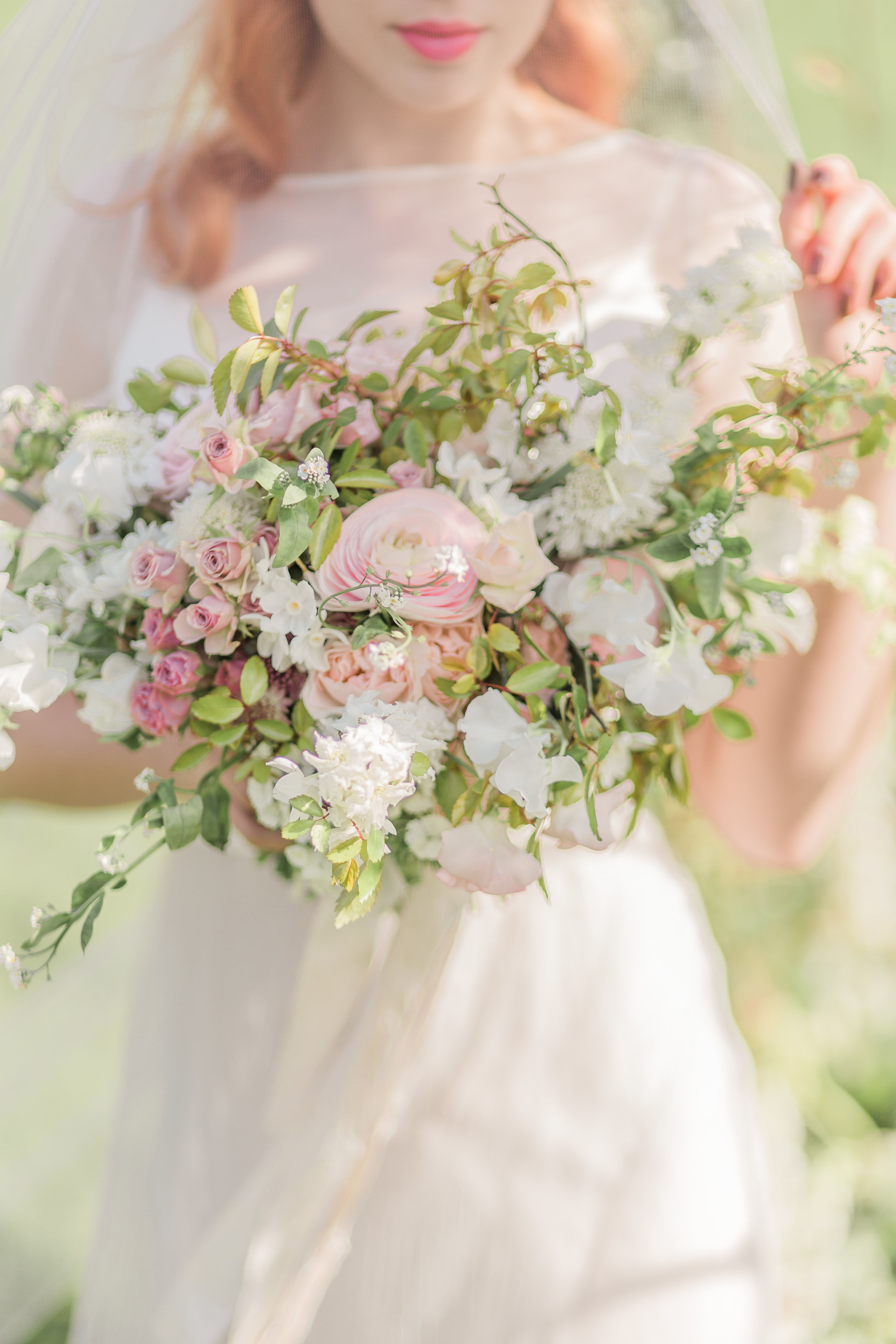 pink ranunculus bouquet by kent flower school jennifer pinder at Chafford Park wedding venue