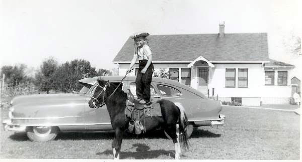 Tom as a kid at his home in Iowa