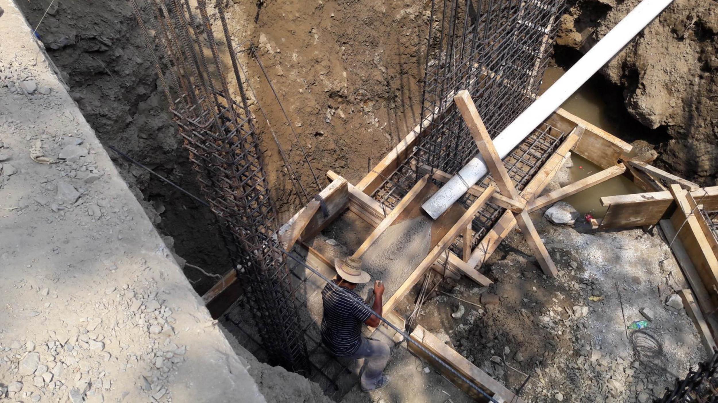 Concrete Through Pipeline to foundations