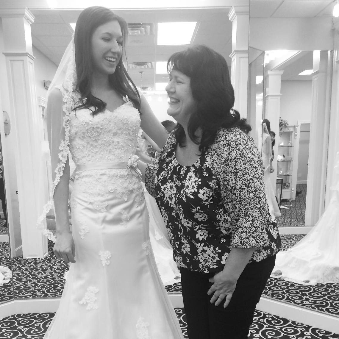 This is my mom and I the day I bought my wedding dress. She was a great helper!