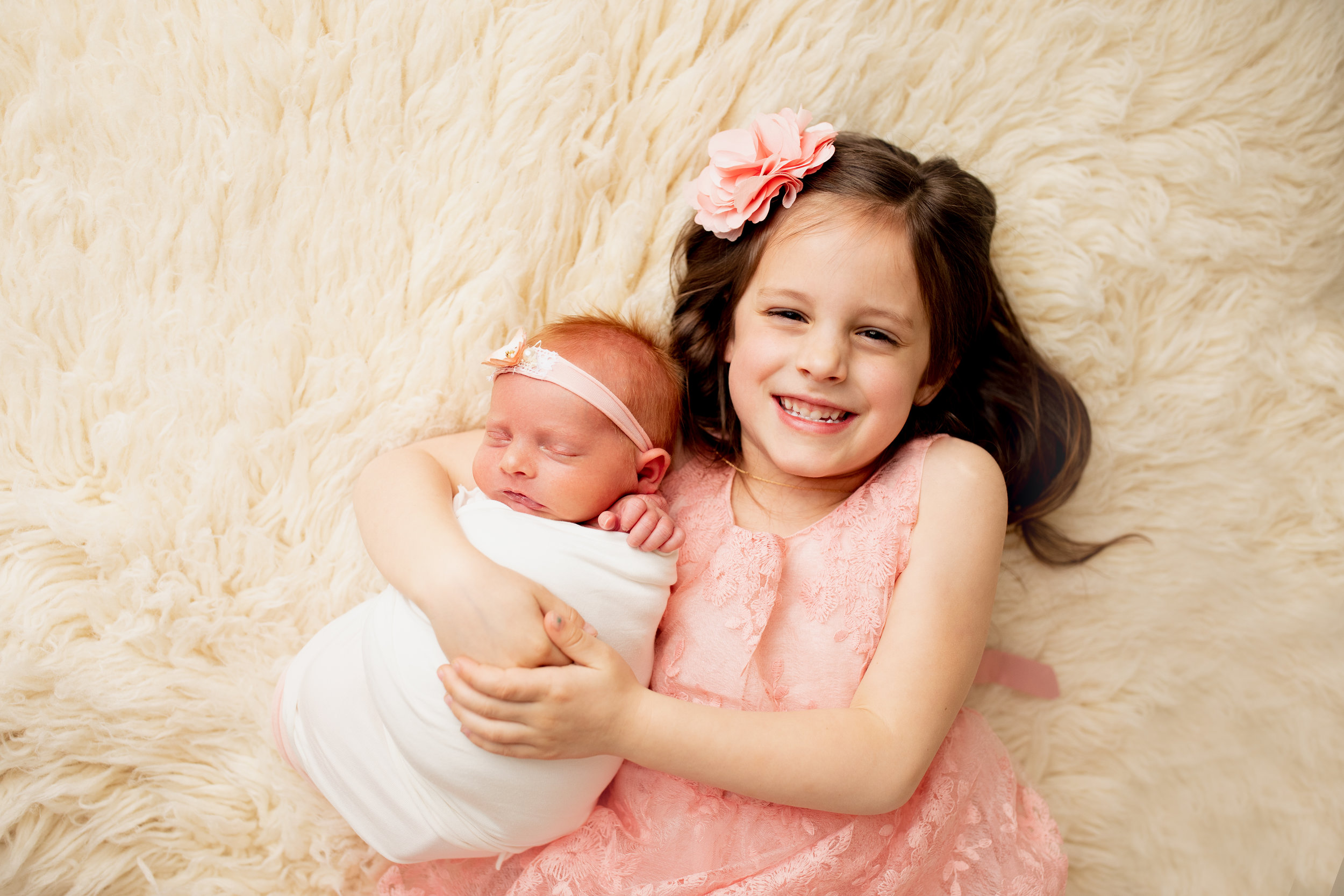 sister and newborn during family photography session
