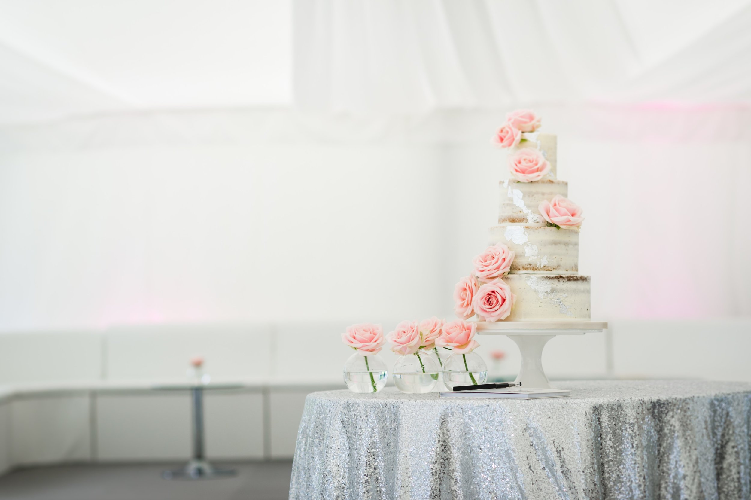 Semi-naked wedding cake with edible silver leaf.