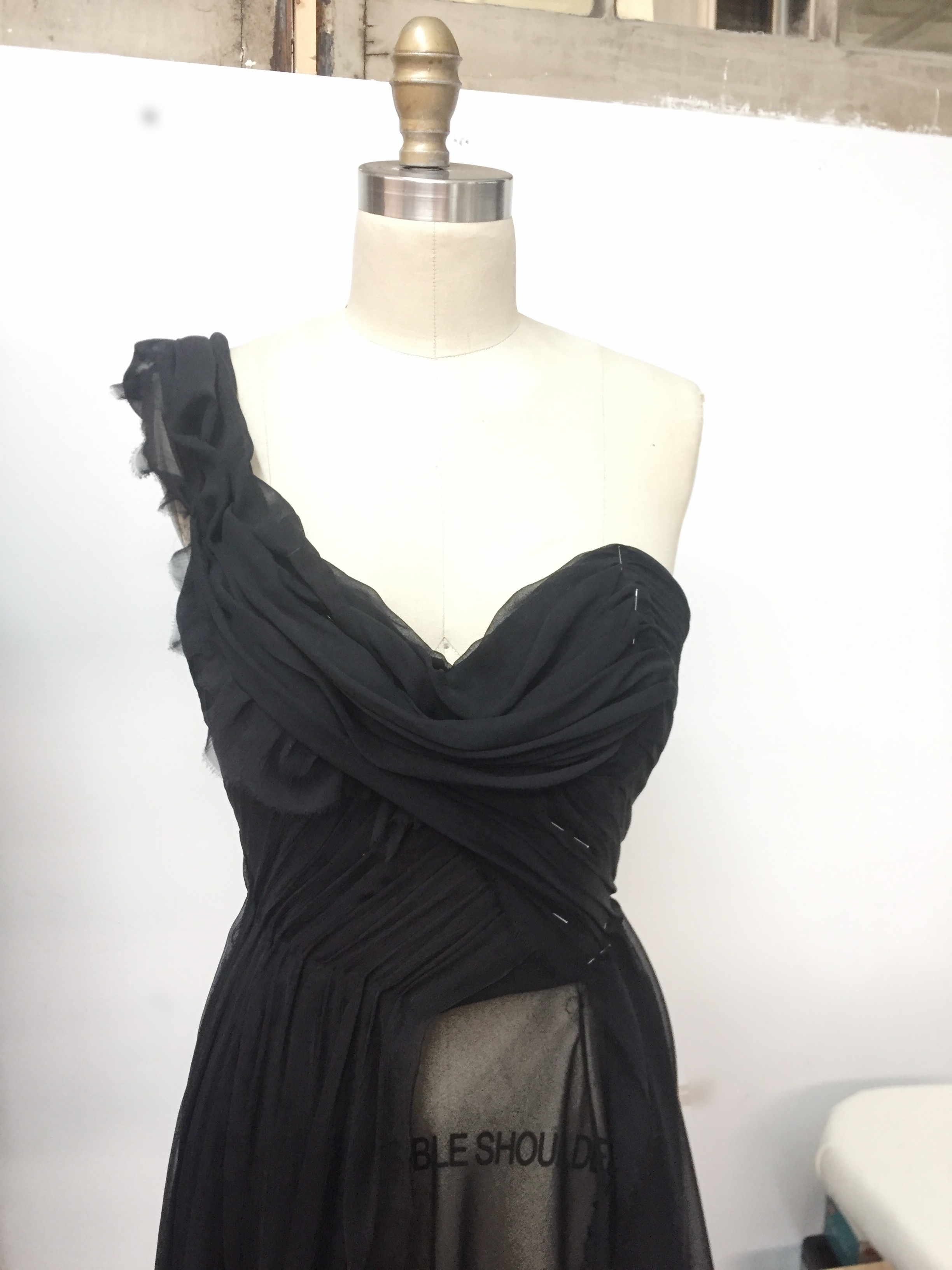 Draping in progress.