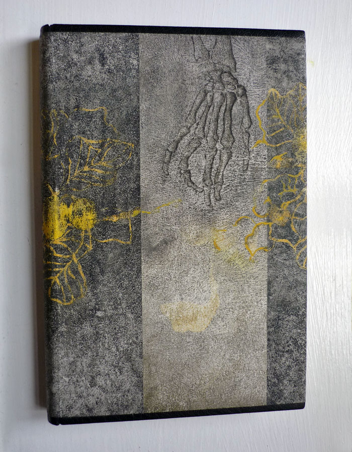 Midori Kunikata-Cockram. The touches of patterned yellow and the variation of the gray texture stand out to me as the exceptional parts of this quietly macabre binding.