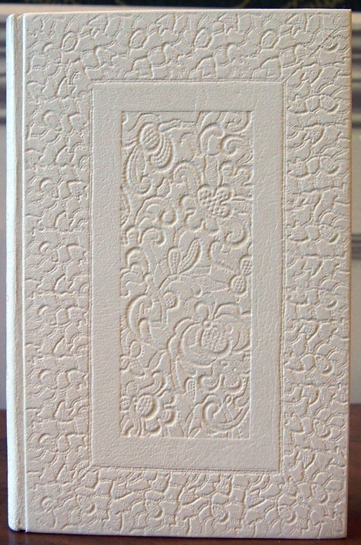 Rachel Ward-Sale. The tooling may not be so crisp; and isn't the most decoratively interesting, but, eh, I'm just a sucker for white bindings and for lots of repetition and building-up of tooling.