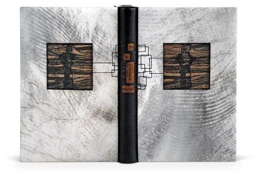 2010 - David Sellars. Painted parchment sides, inlaid suede with printing.Very nice. http://www.designerbookbinders.org.uk/exhib/booker/booker_2010/booker_6.html