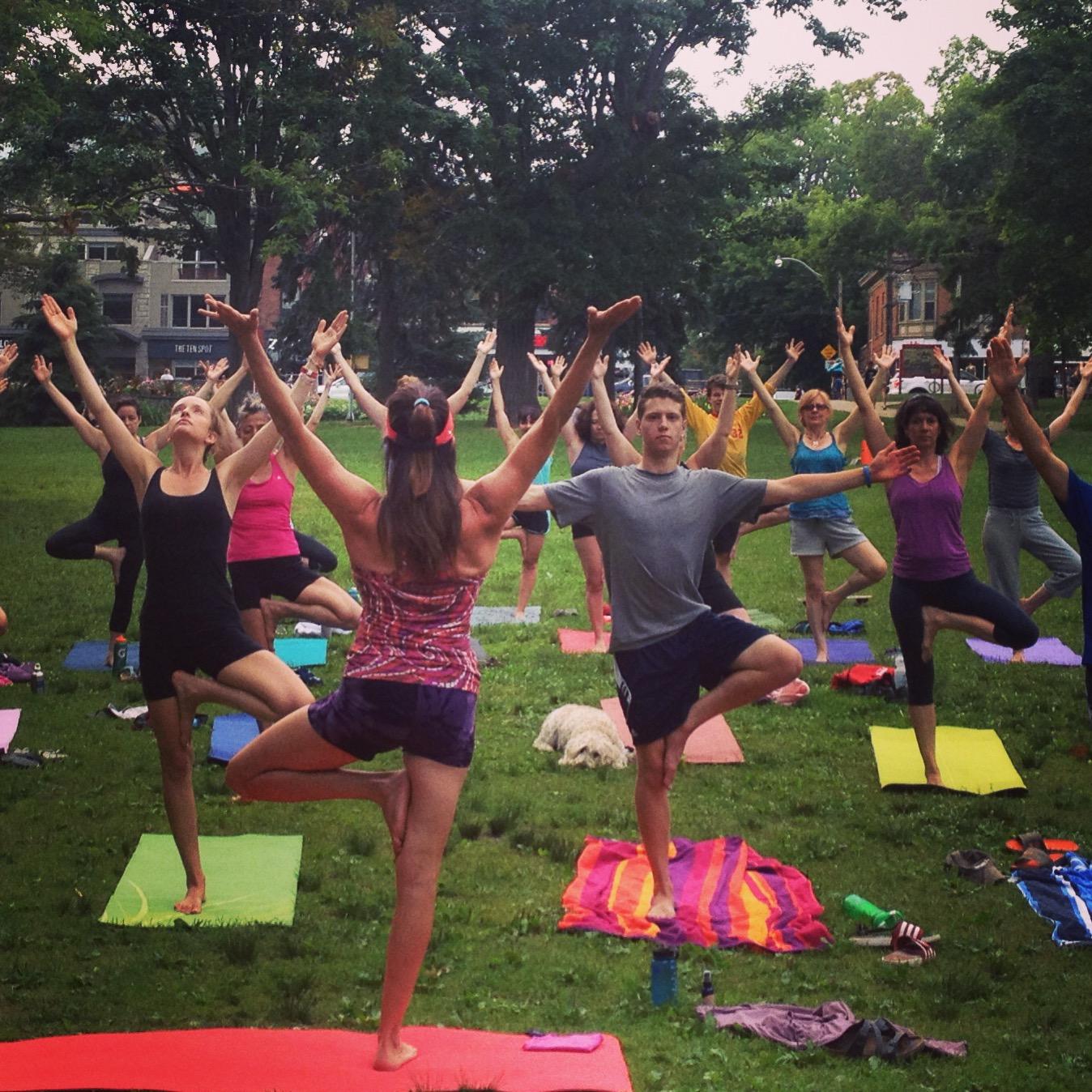 Lisa Rochon teaching an evening yoga class at historic Kew Gardens, Beaches, Toronto.