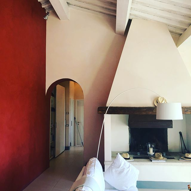 The hearth makes us want to gather. Way up high, top of a rough stone trail, we discovered this one in Tuscany. #interiordesign  #gathering #tuscany