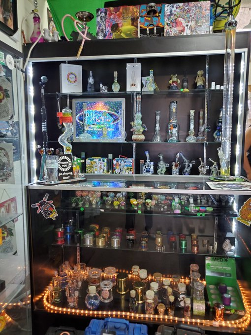 Just a small sample of the glass at Top Shelf Gift Shop. Waterpipes, handpipes, rigs, stash jars, and pendants — it's all here.