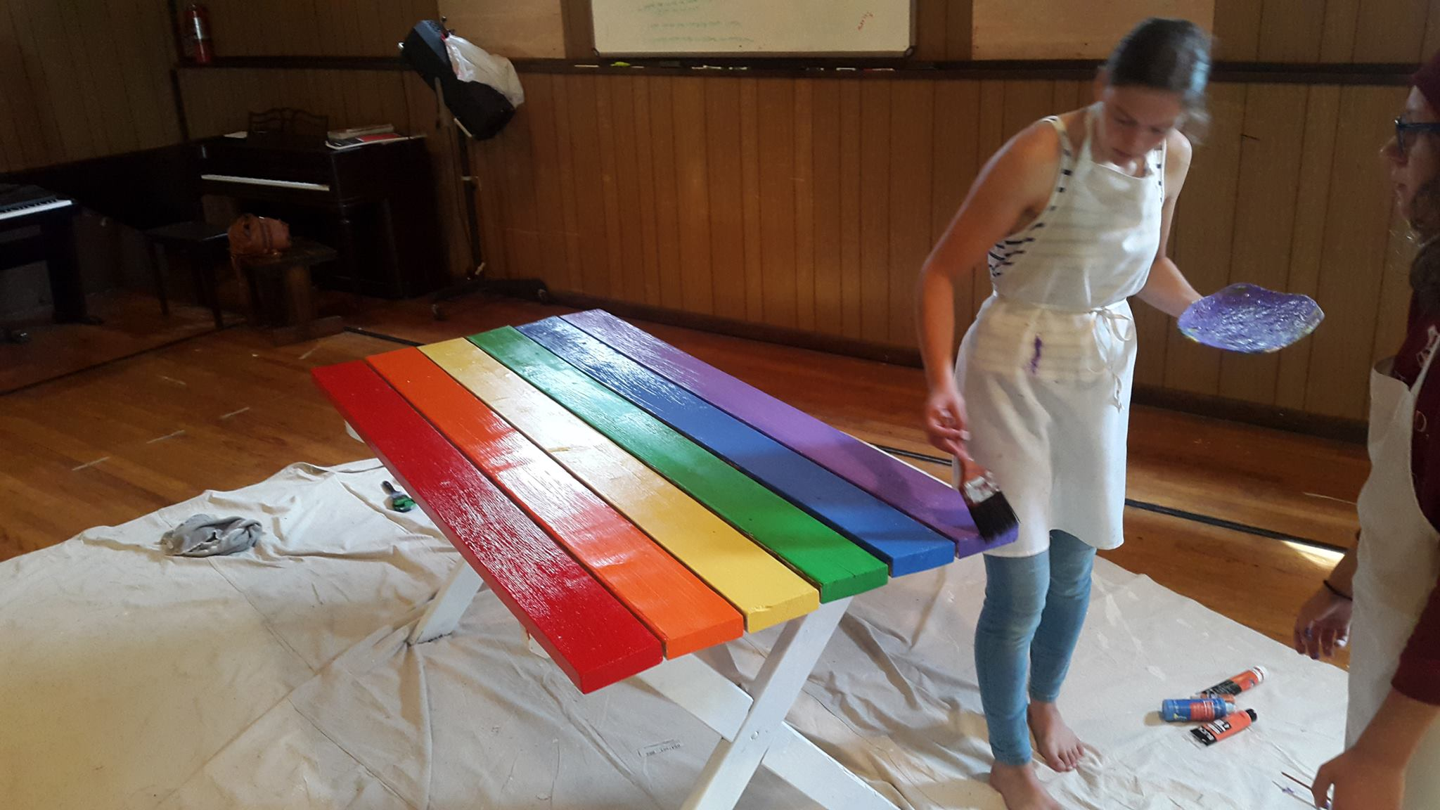 Sigrid (Norway) painting benches during project tim .
