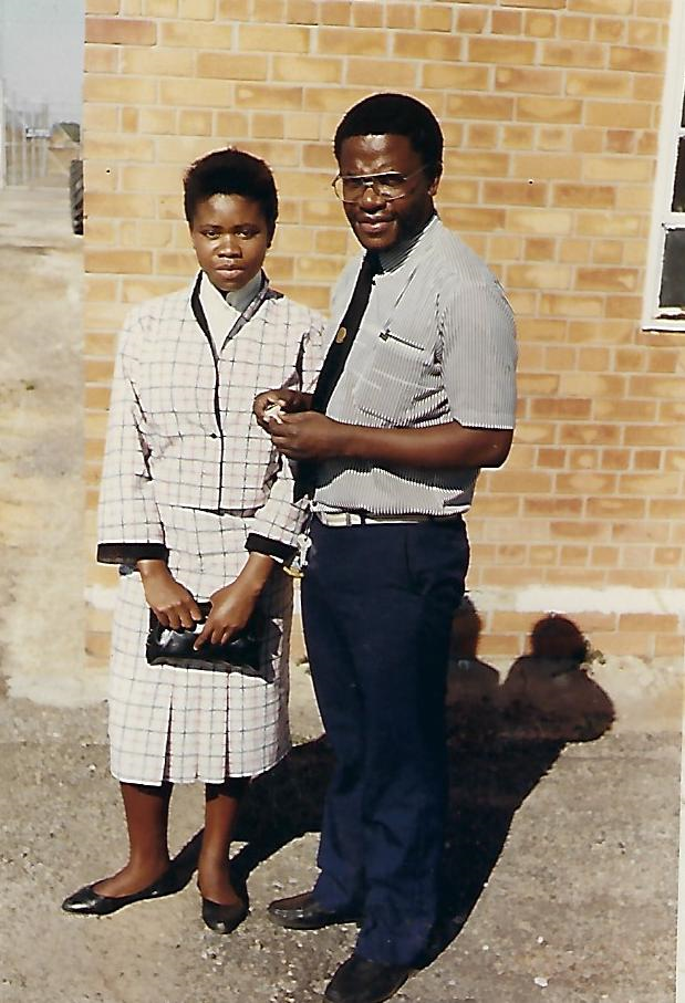Grace and her father at an airport in Zambia before camp.