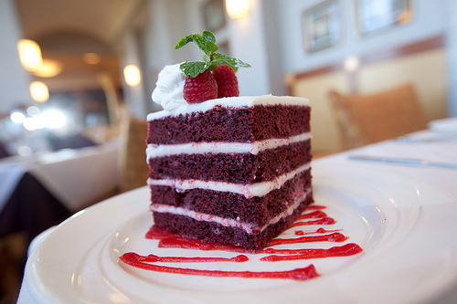 Red Velvet Cake   Like all great desserts, this cake is a celebration of excess. Tons of chocolate cake. Tons of red food dye. Tons of cream cheese frosting. It's no surprise that this traditional Southern dessert packs such a big taste. Raspberry sauce completes the dish.