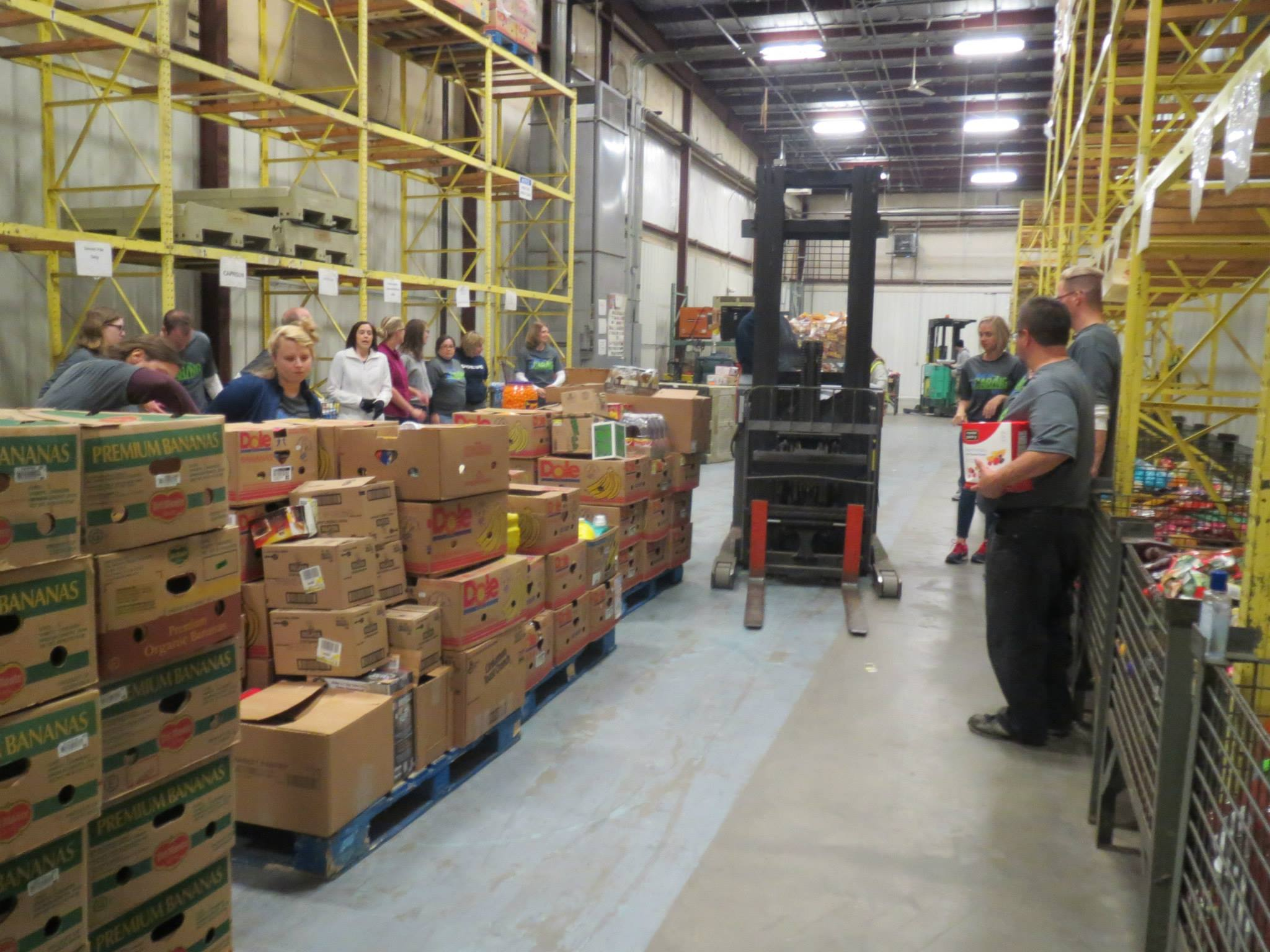 I didn't manage to get a picture of the warehouse on the tour, but let me tell you, it is huge. Here is just one of the aisles of the warehouse from the   Community Harvest Facebook   page.