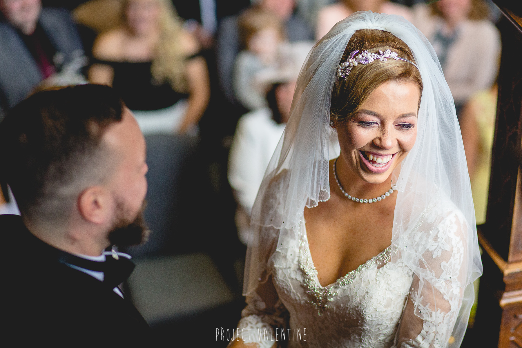 bride laughing during service