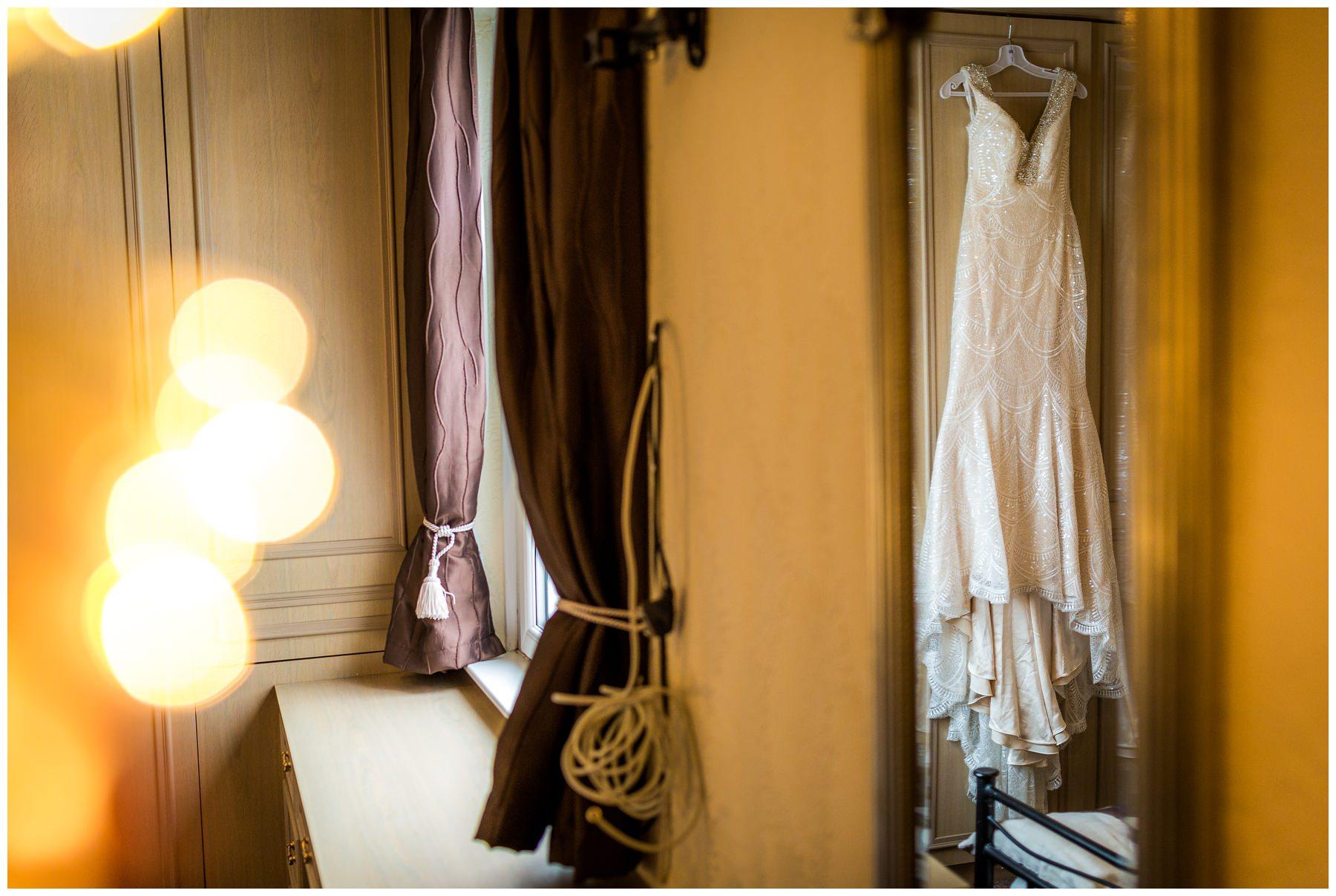 wedding dress hung in bedroom