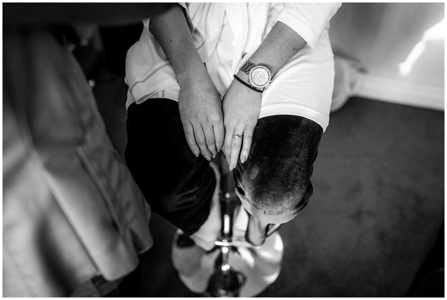 brides hands during makeup