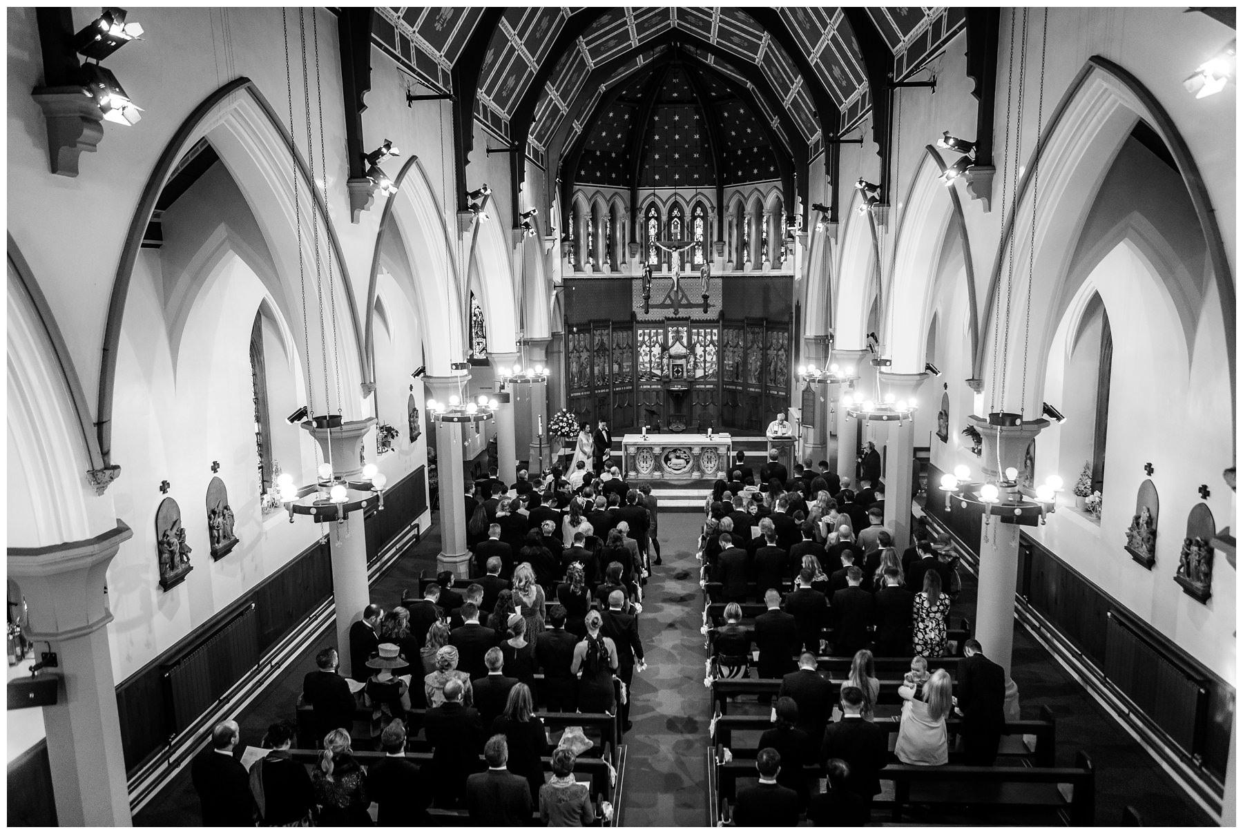 shot from back of church showing all the wedding party