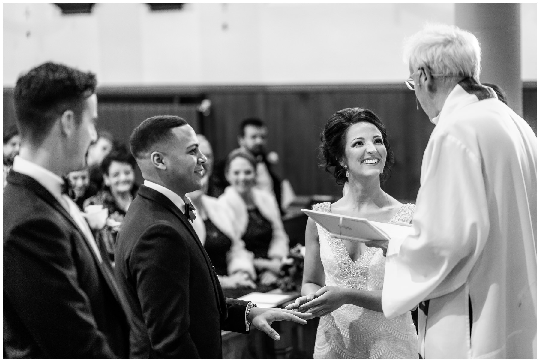 bride smiling to vikor as they exchange rings