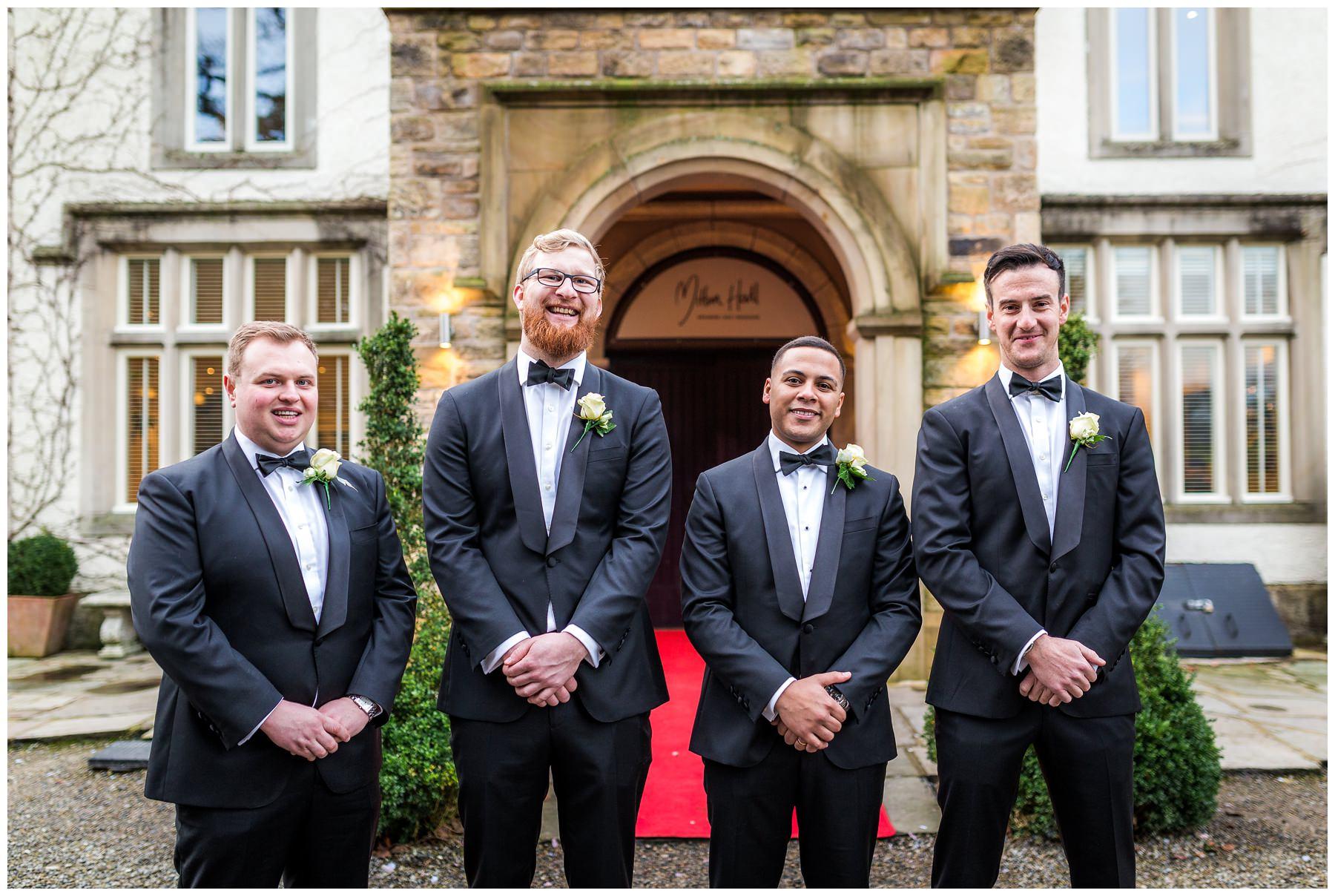 groomsmen smiling during portraits