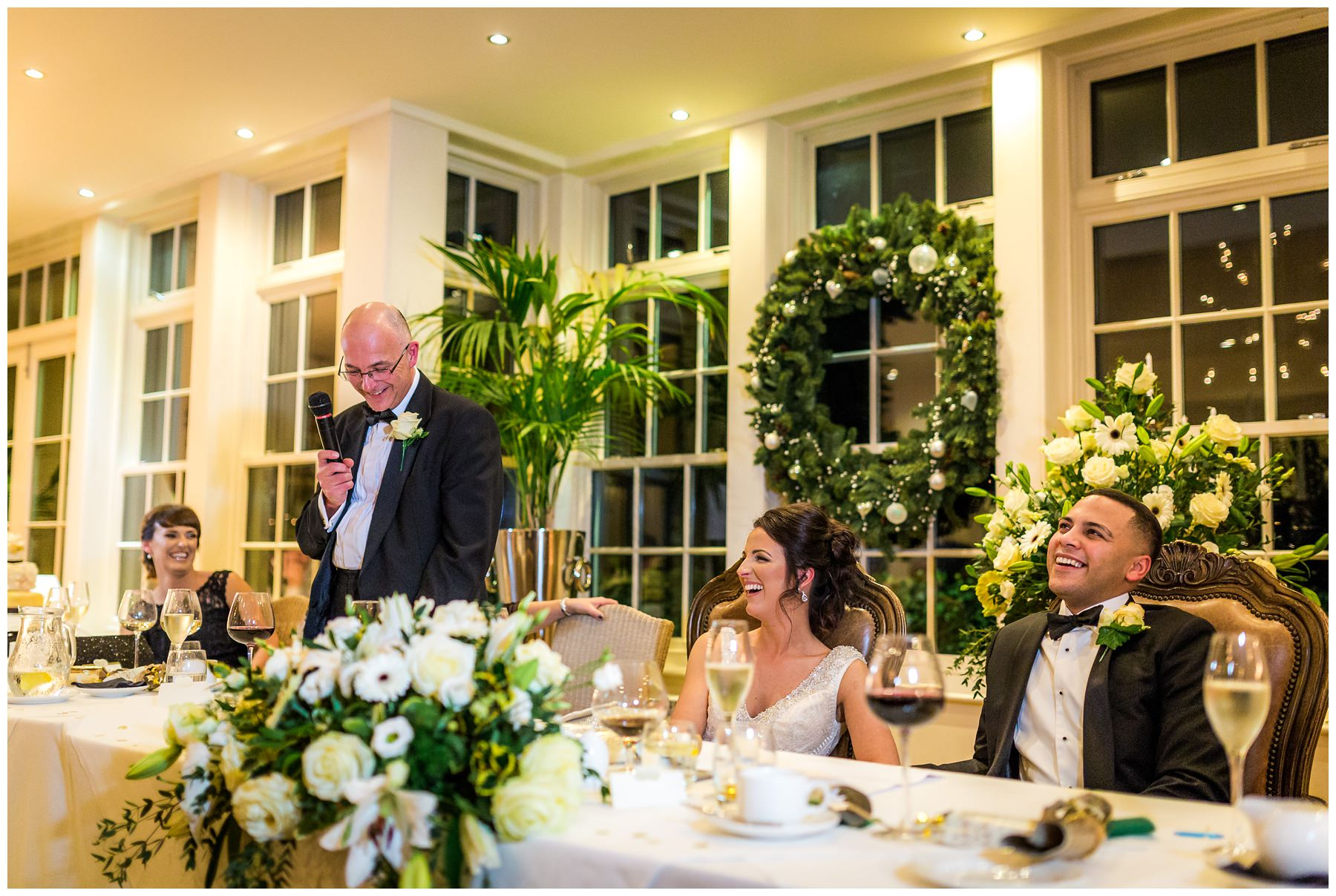 dad giving his wedding speech at the top table