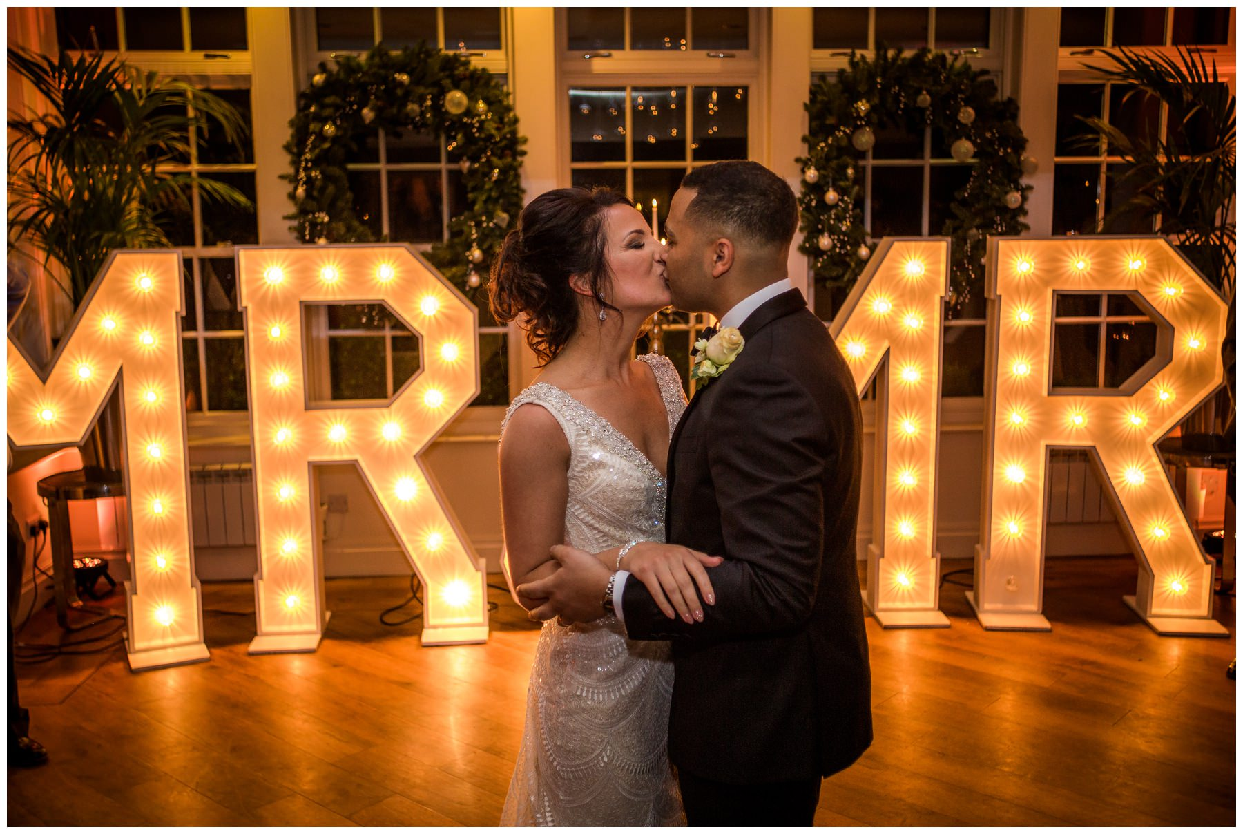 Bride and Groom kissing during their first dance