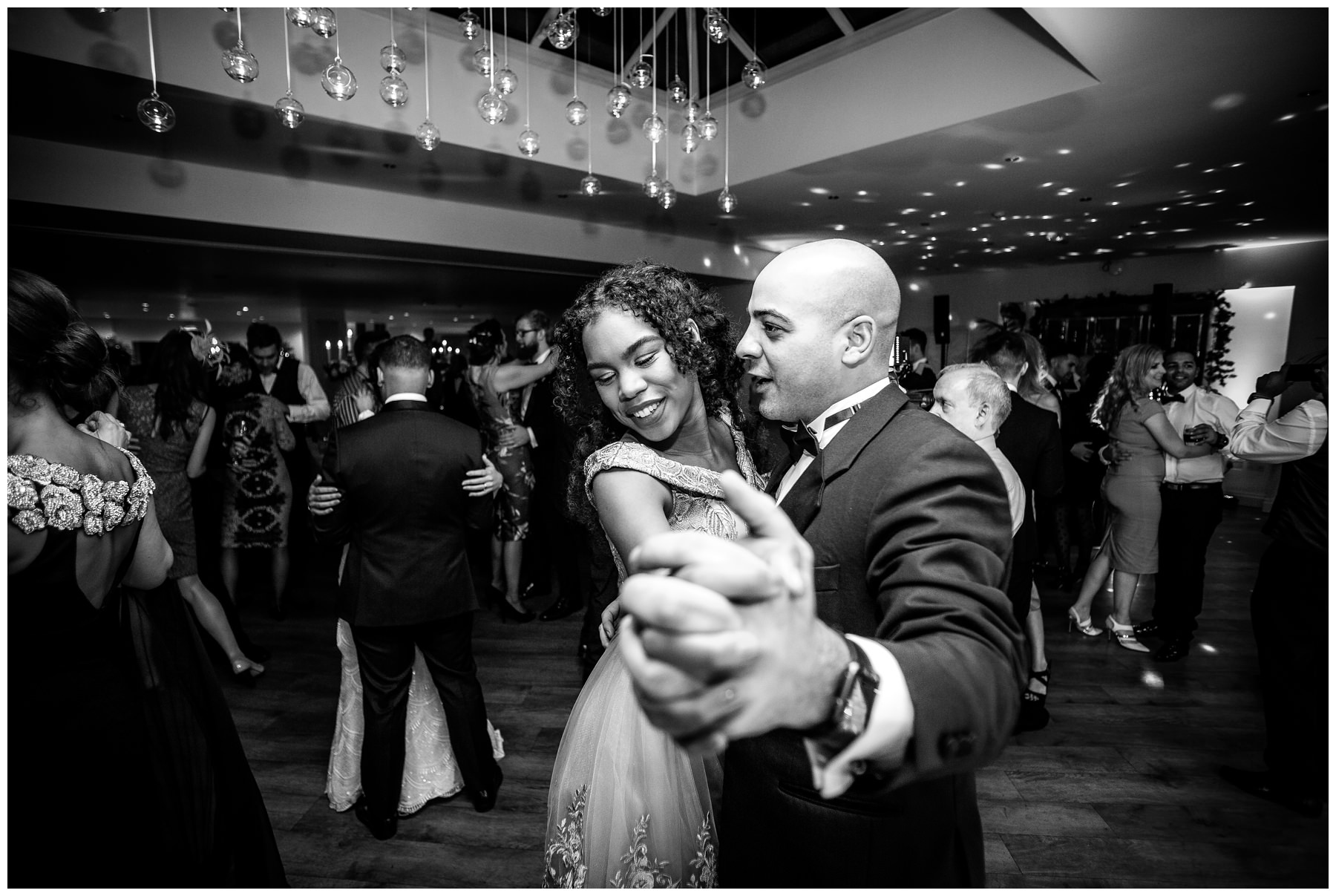 guests dancing during the night with hands locked together