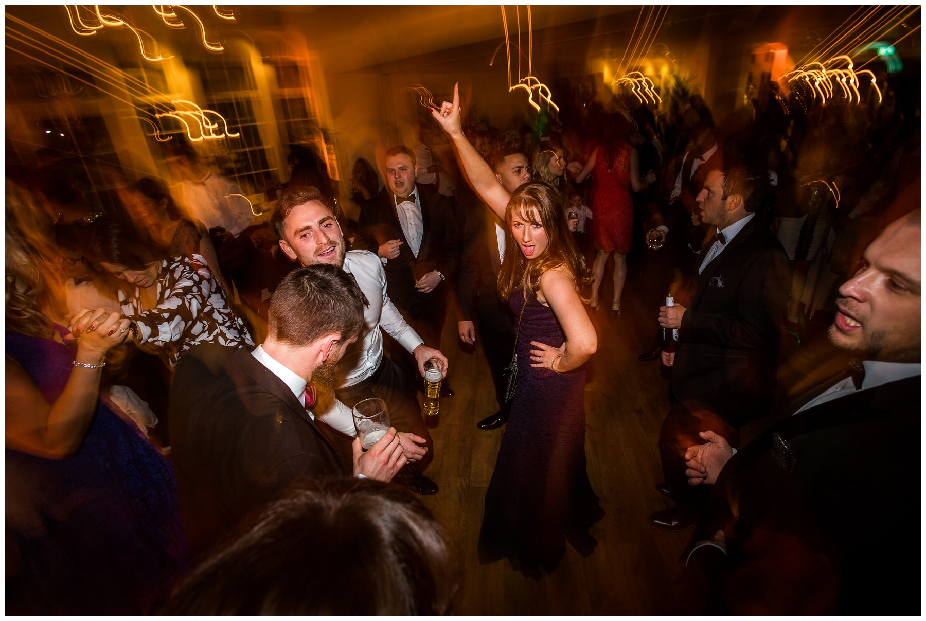 guest dancing with arm pointing in the air