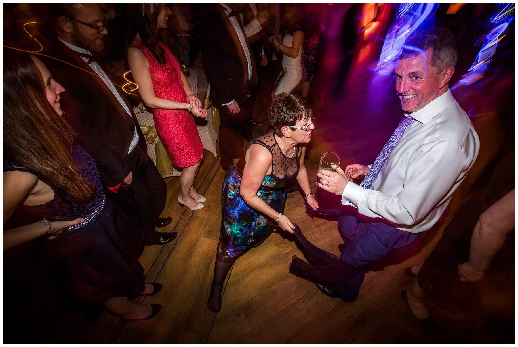 brides mum about to slip while doing the splits on the dance floor