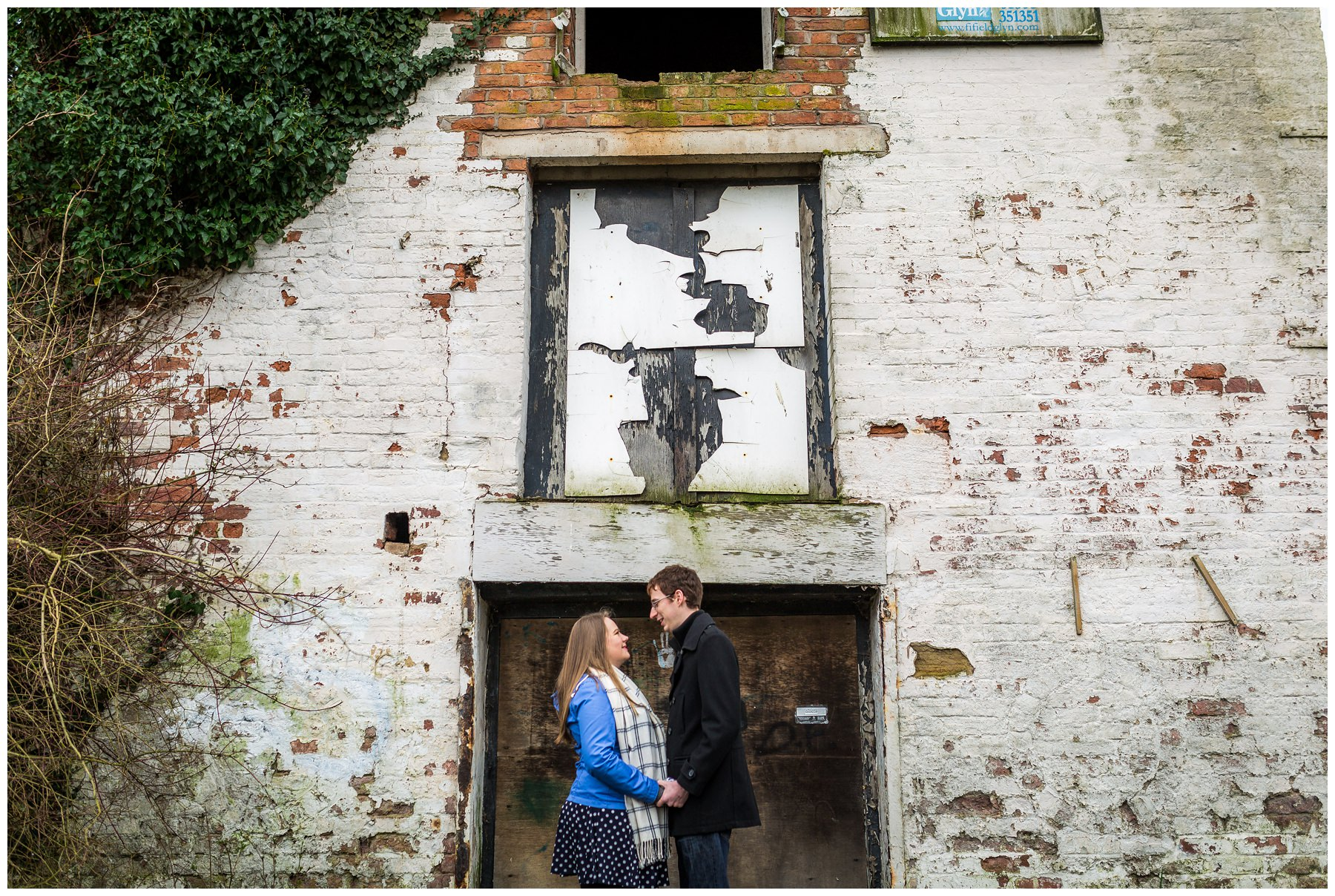 couple in front of abandoned building
