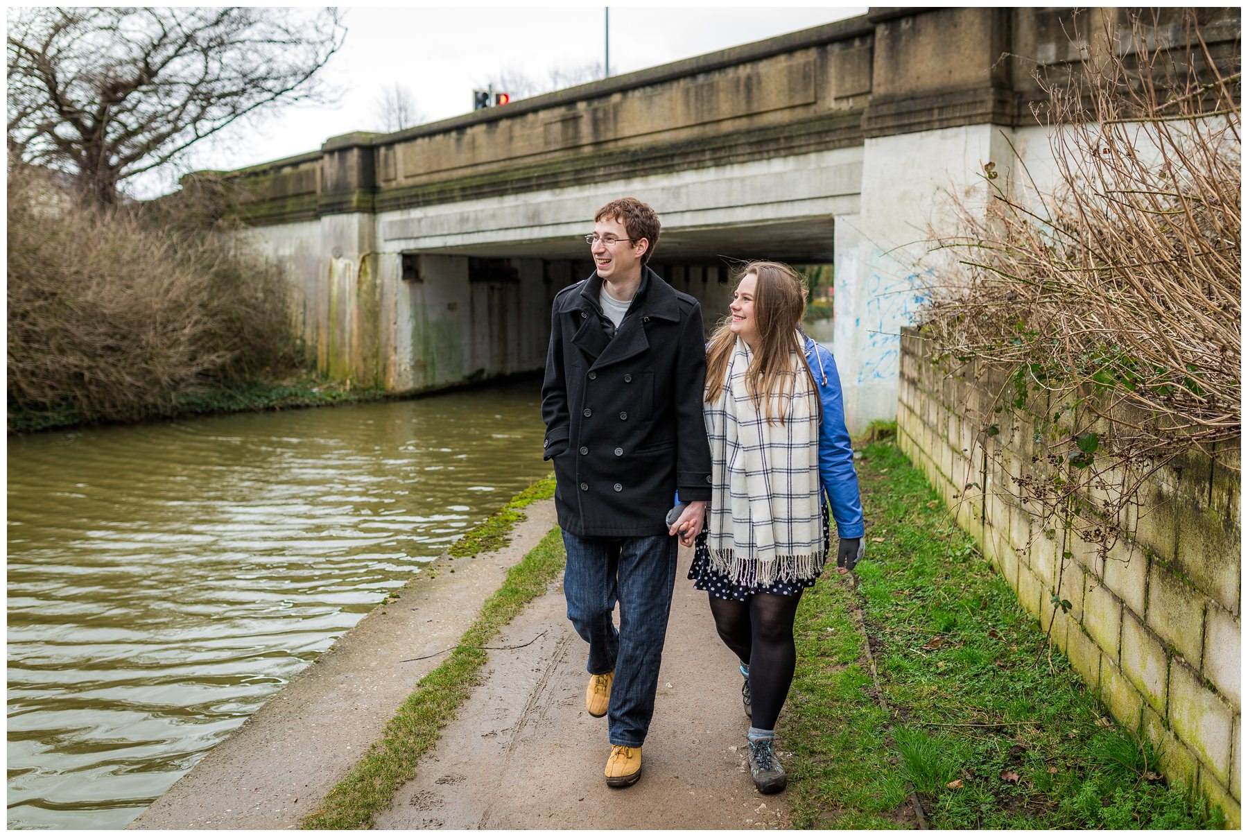 couple walking down Middlewich, North West, canal
