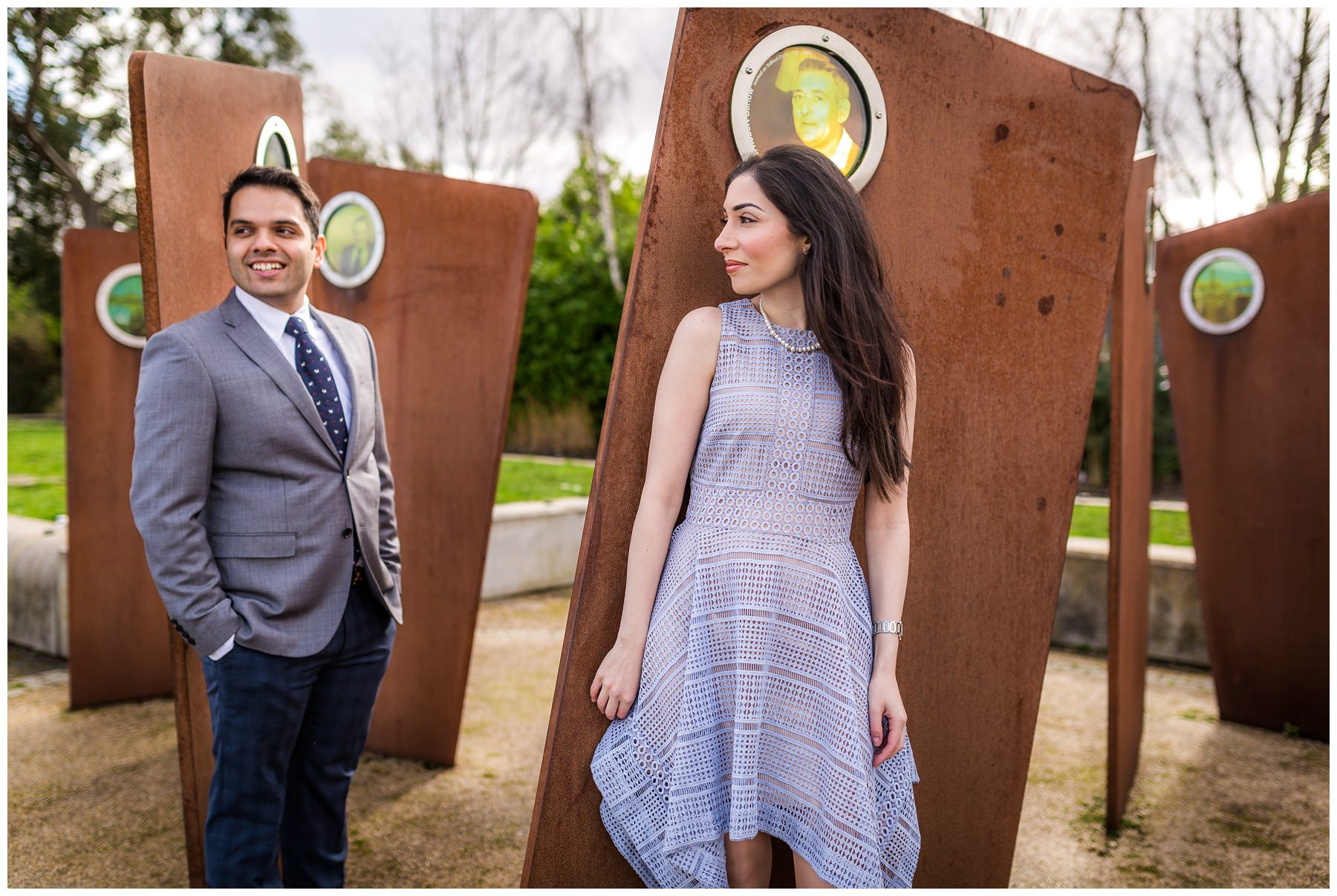 couple standing in front of iron structure