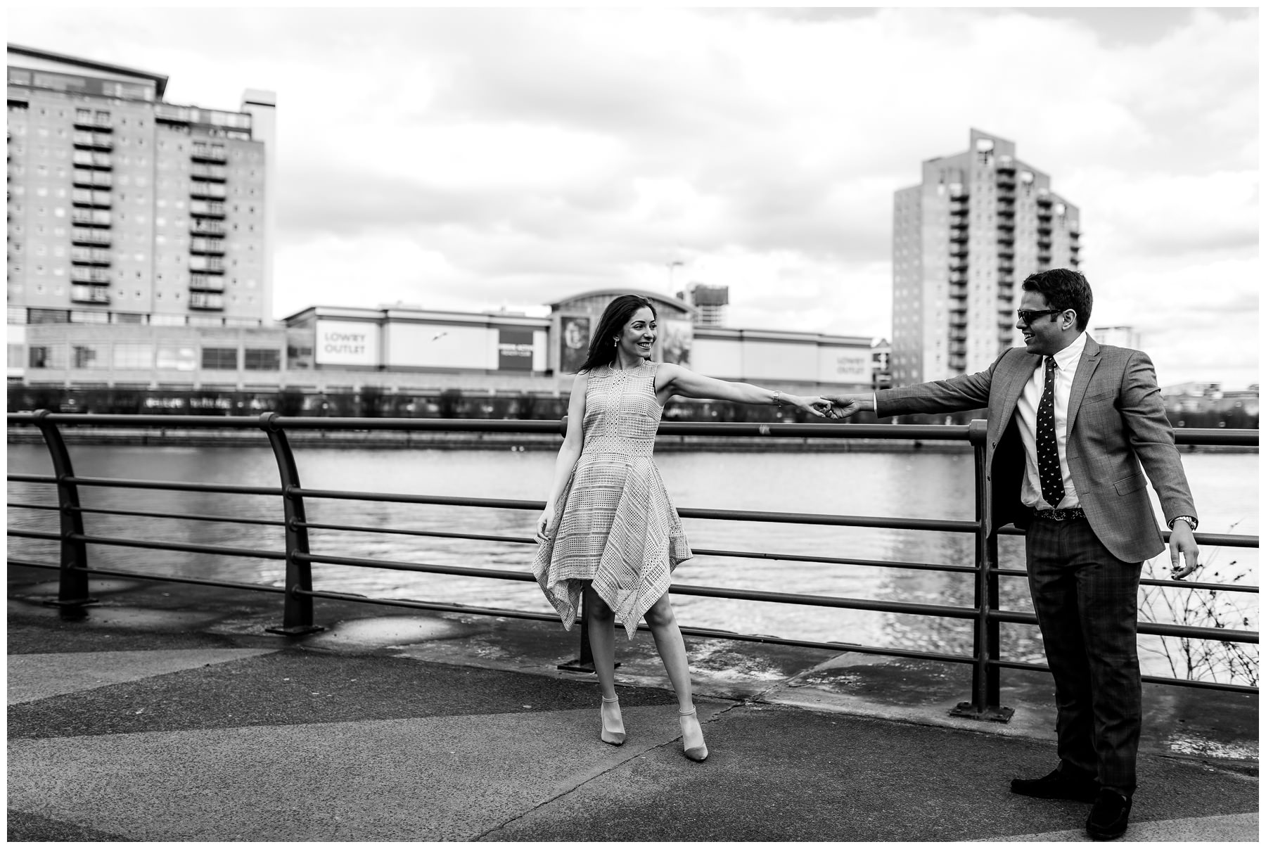 couple dancing in front of salford quays, north west