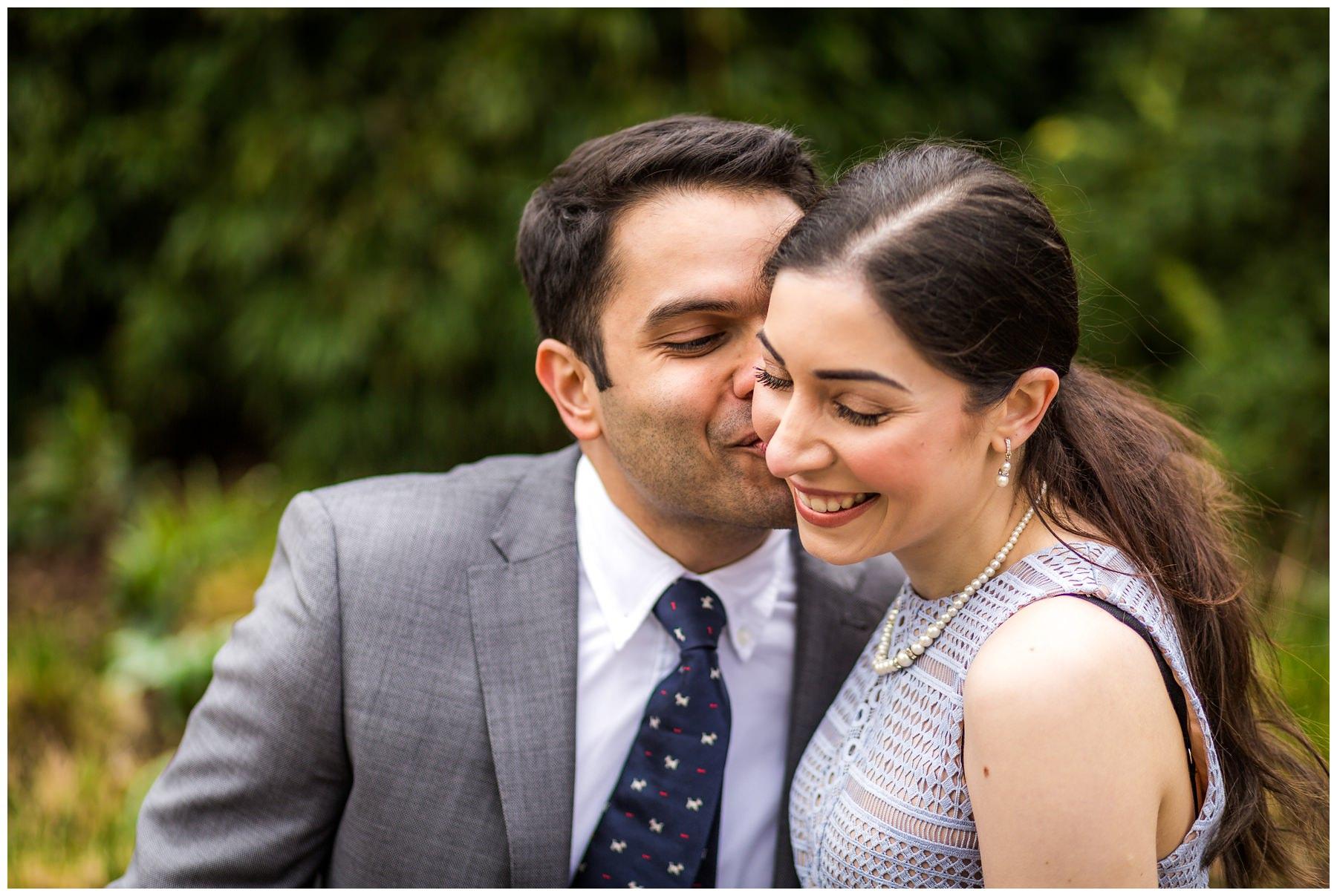 groom kissing brides cheek, close up
