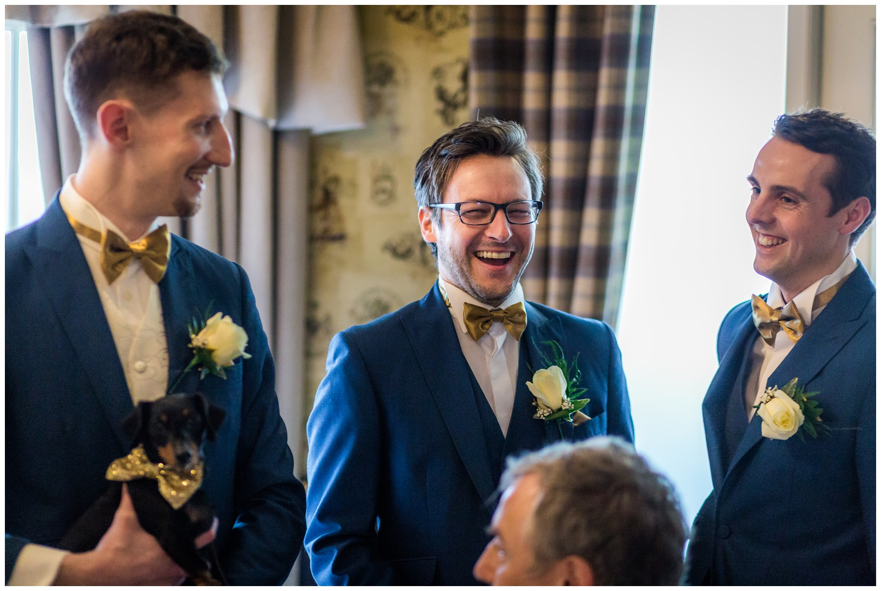 groom laughing with best men