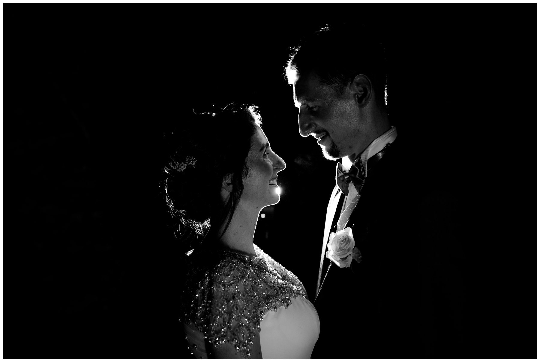 bride and groom at night with silhouette