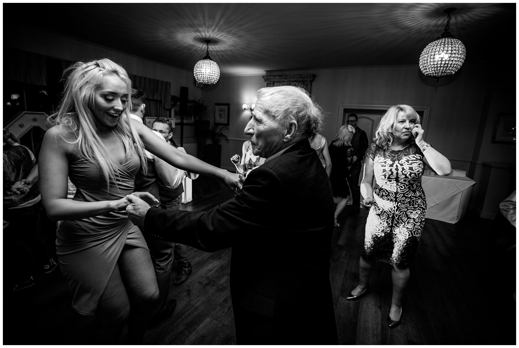 young girl dances with older man