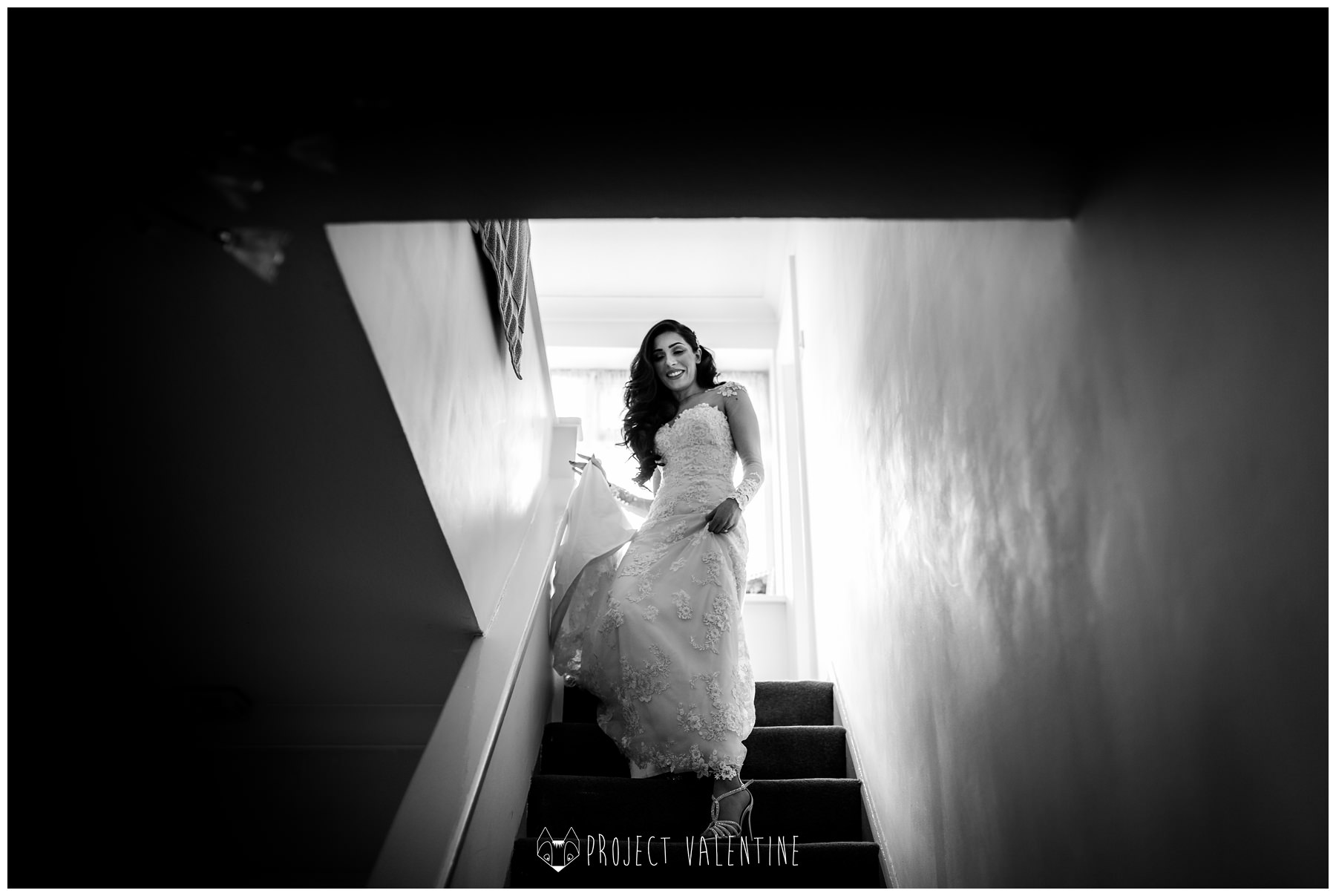 bride walking down the stairs in her wedding dress