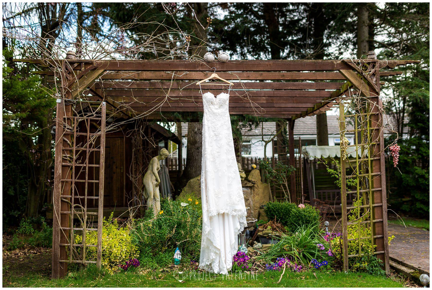 the wedding dress hung outside